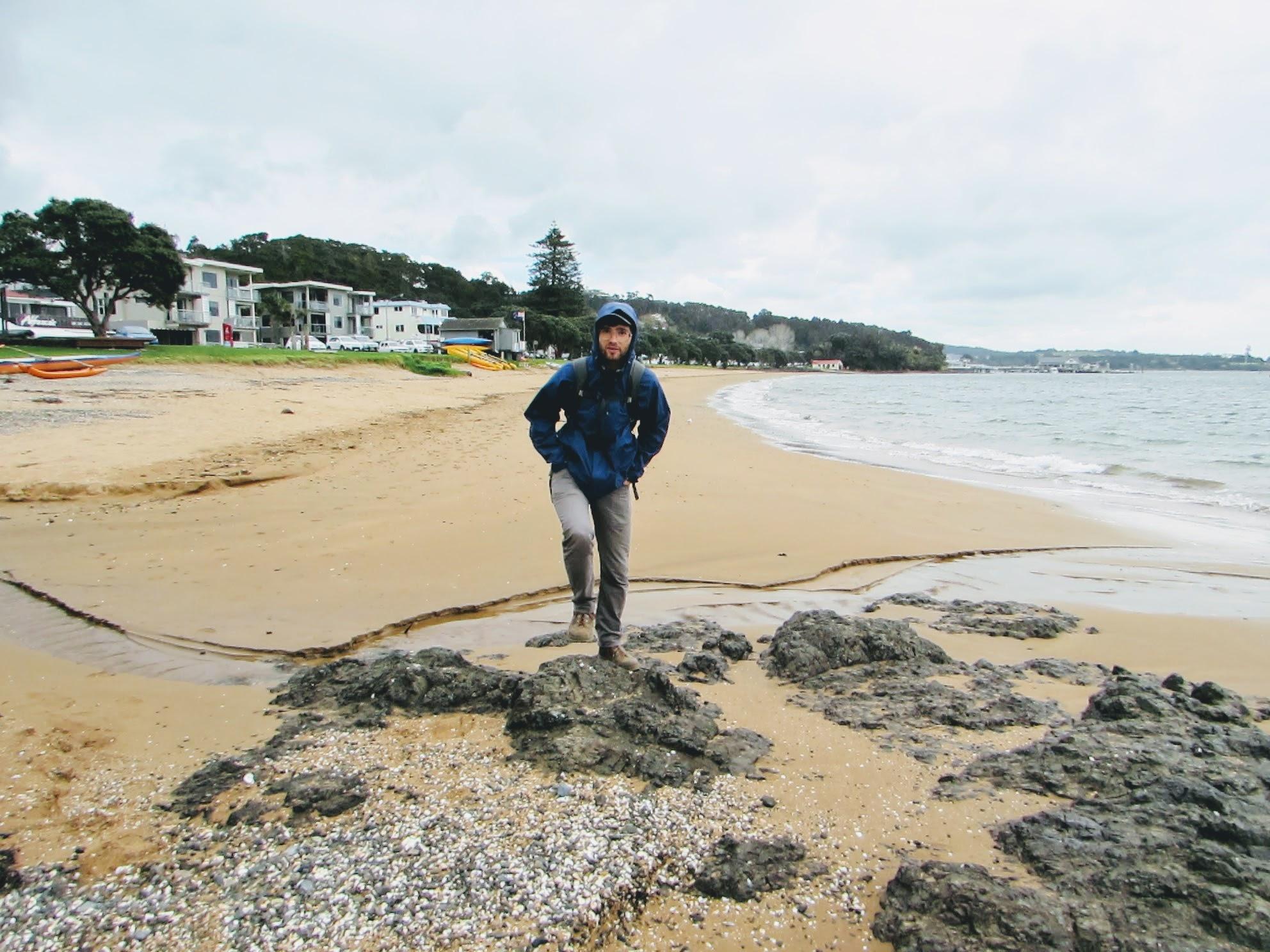 Emmett on a typical New Zealand rainy day on Paihia's beach.