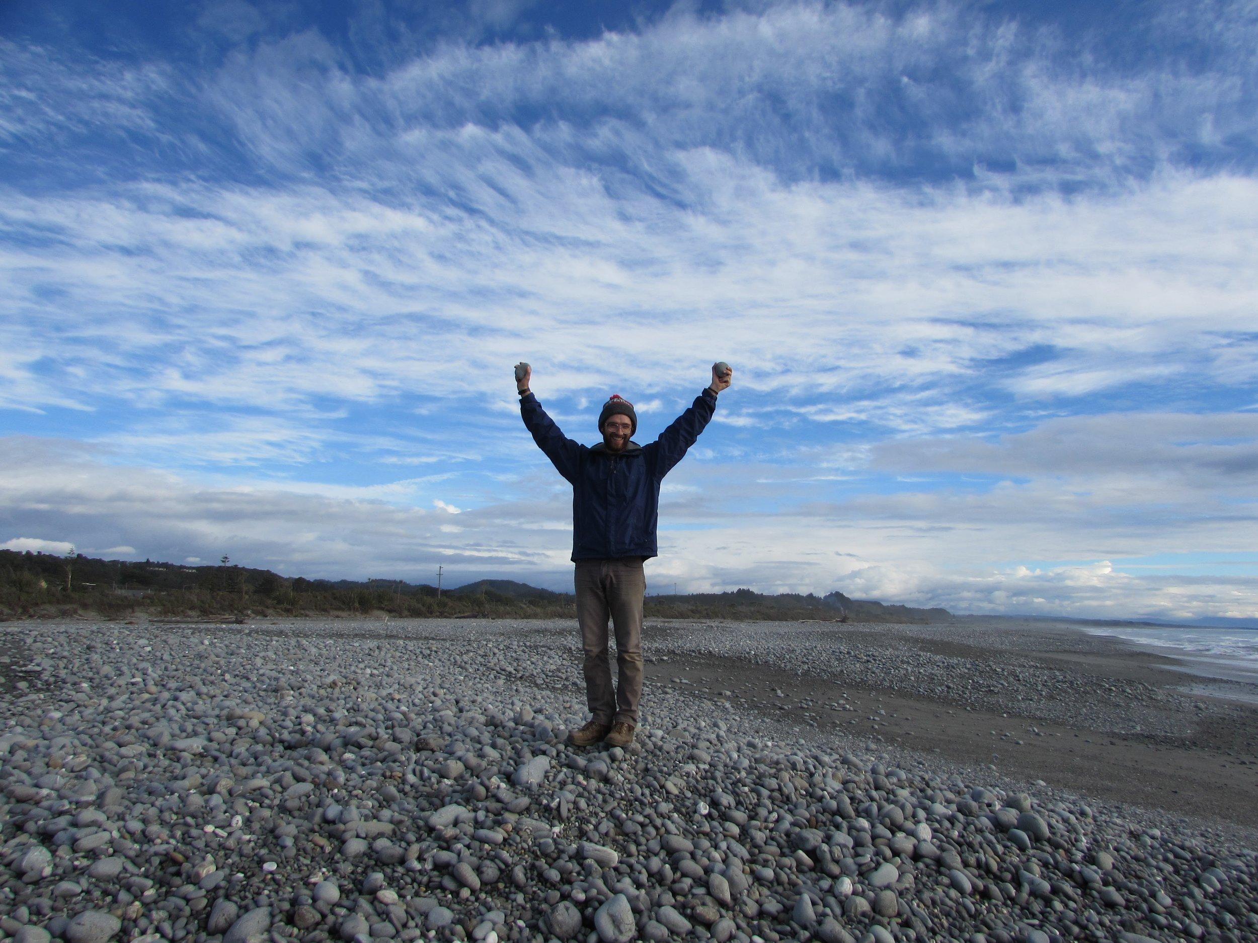 A triumphant Emmett on the rocky beach of Greymouth.