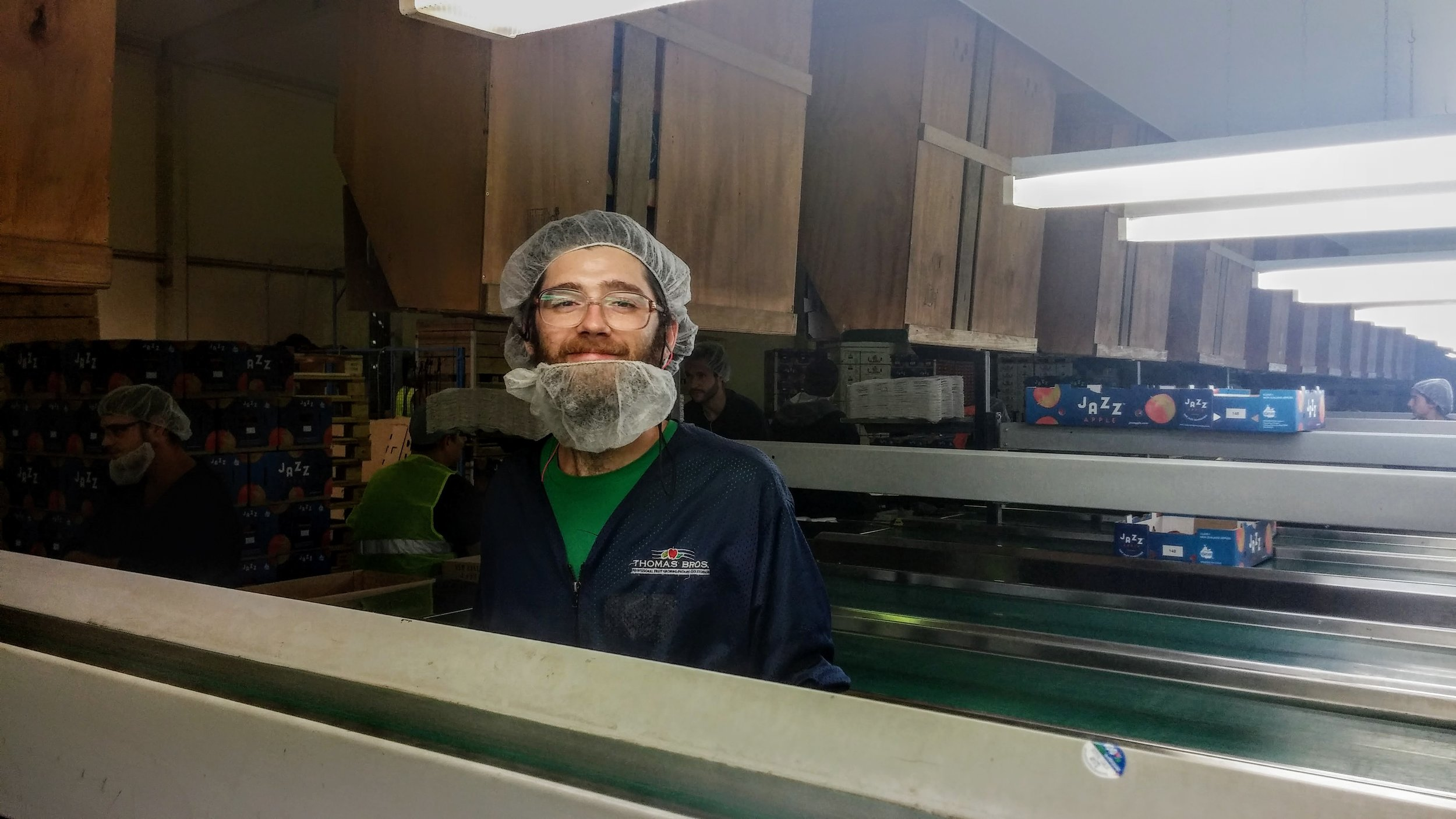"""Emmett has to wear a hairnet and a beardnet which our employers call a """"snood."""" (I think it's kinda hilarious)."""