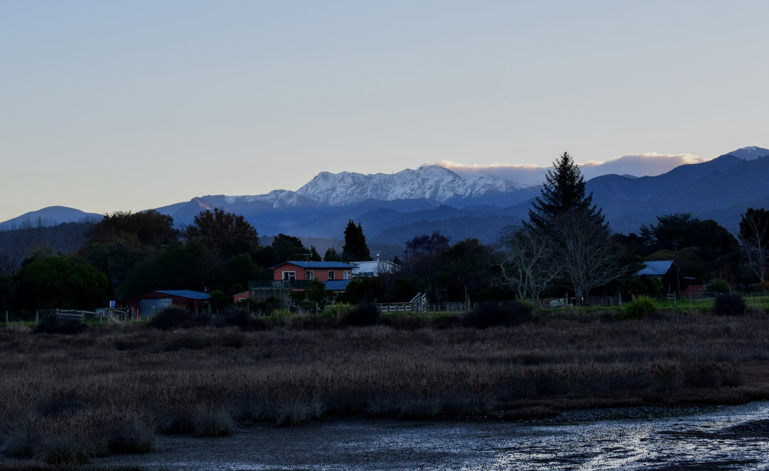 Kahurangi National Park's snow-capped Mount Arthur, as seen from the Motueka Inlet Walk.