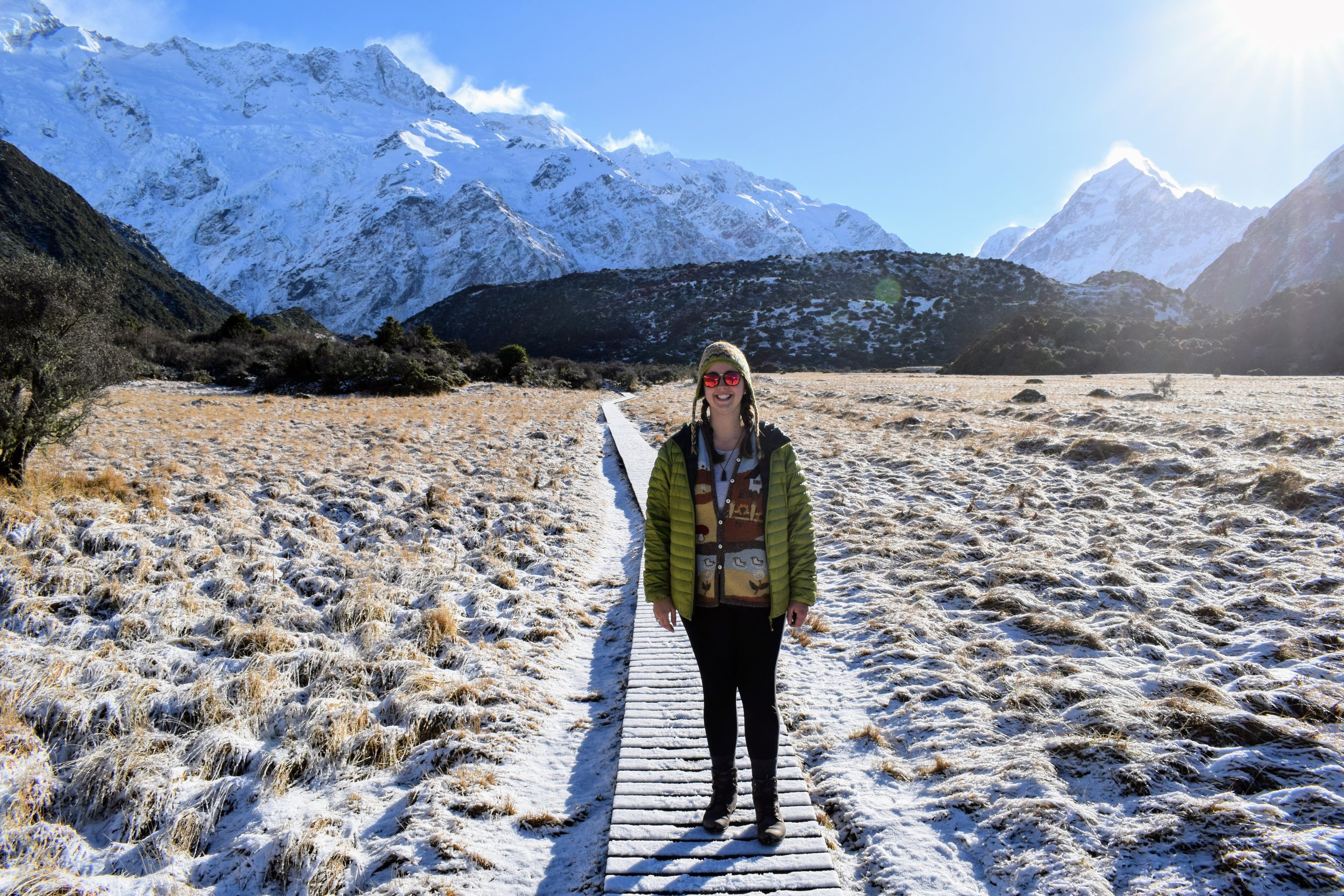 Yours truly on the way to Kea Point. Mt. Sefton on the left; Mt. Cook on the right.