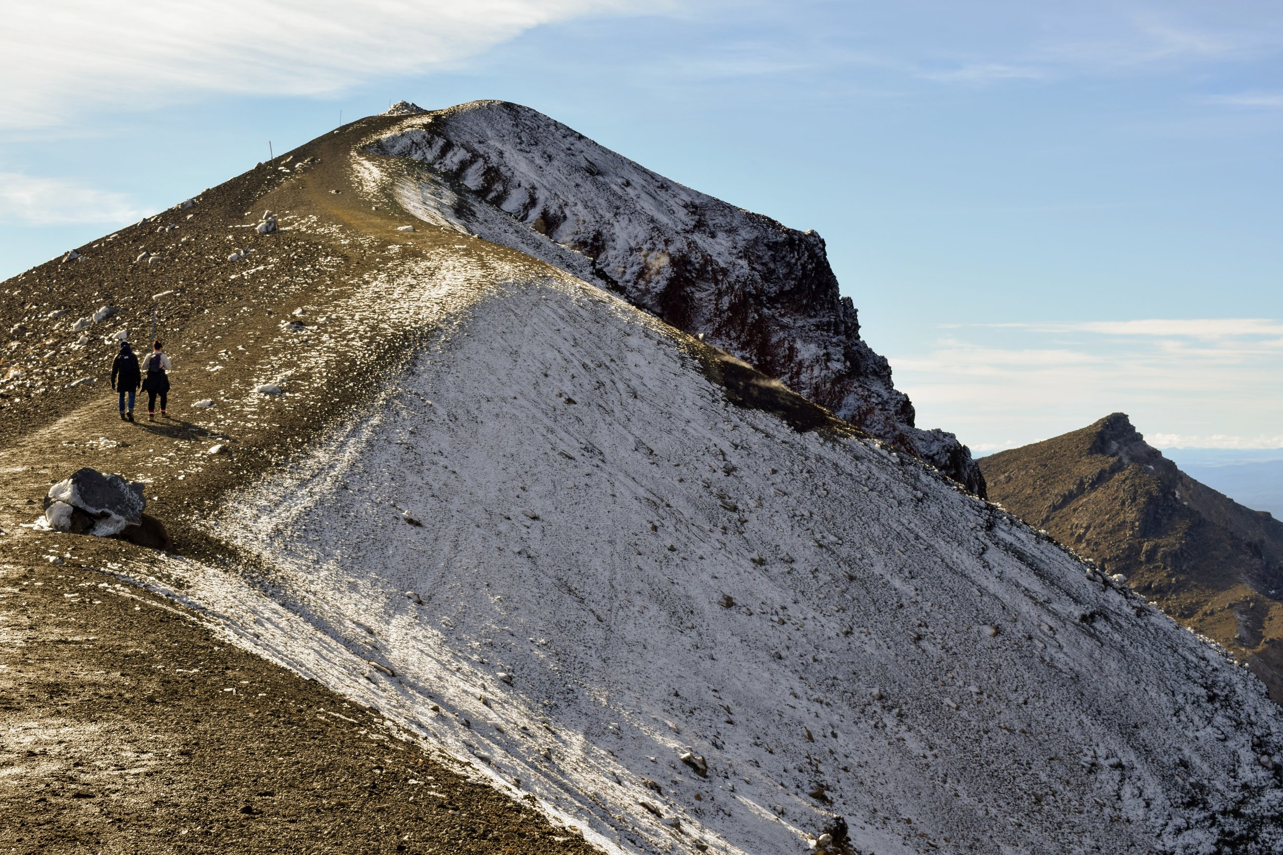 The steep path along the Red Crater's snowy edge.