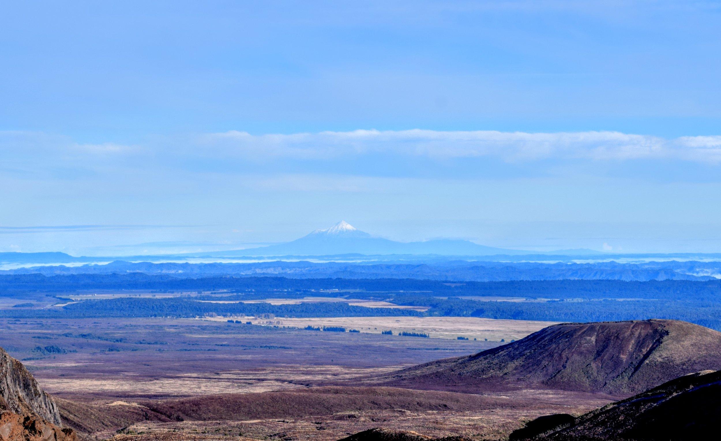 Mount Taranaki, seen from the foot of Ngauruhoe. Taranaki is 130 km (80 miles) due west of Tongariro.
