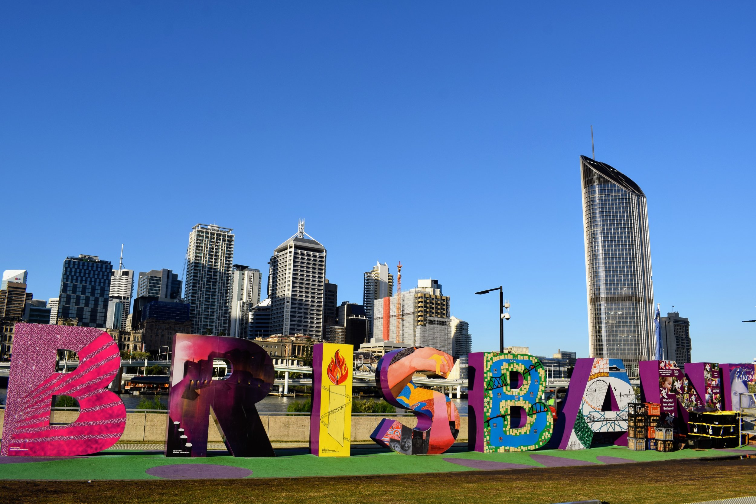 The photogenic BRISBANE letters on South Bank.. only partially covered by gear as workers setup the stands for the next days Night Noodle Markets.