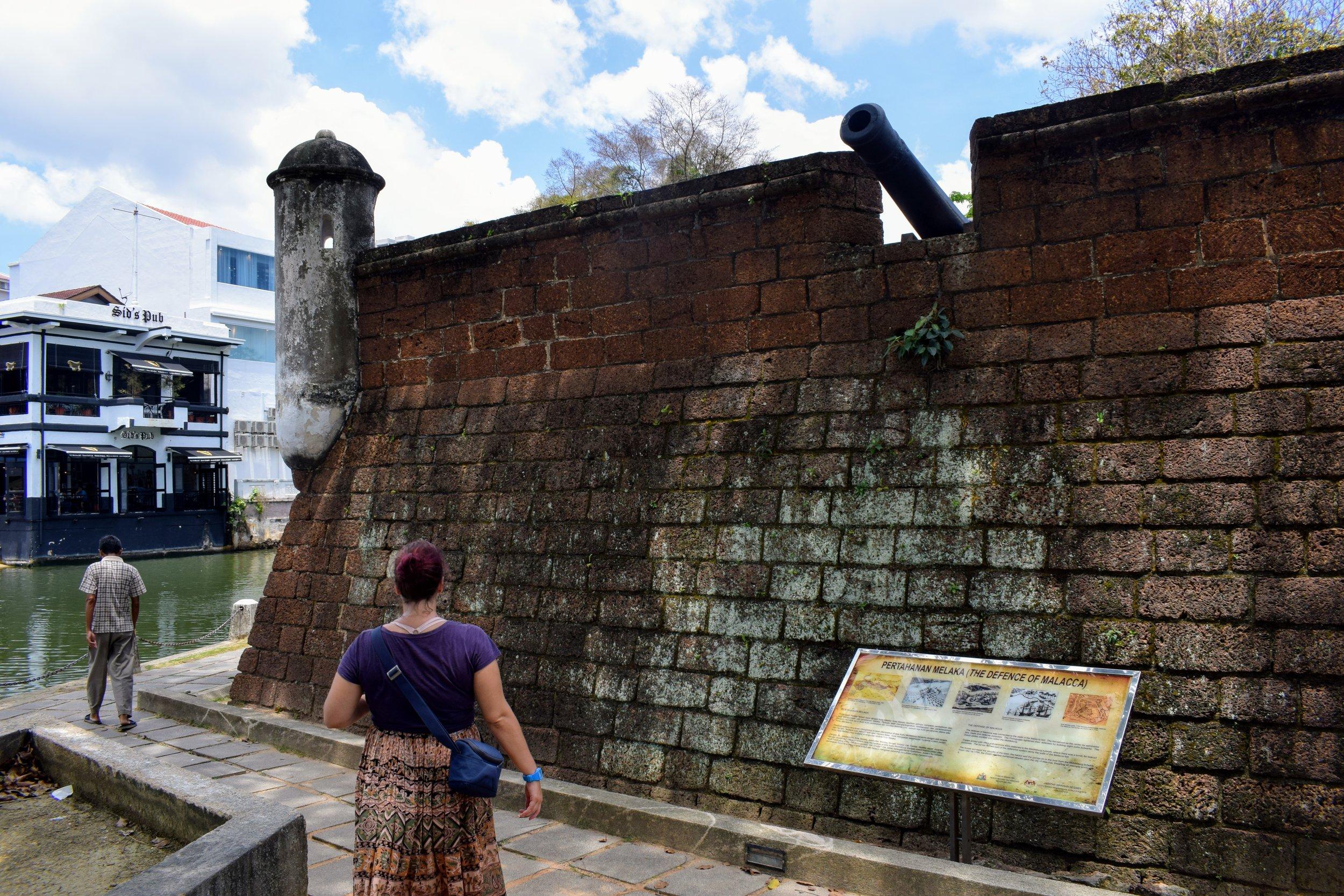 Walking along the old Dutch fort along the Melaka river.