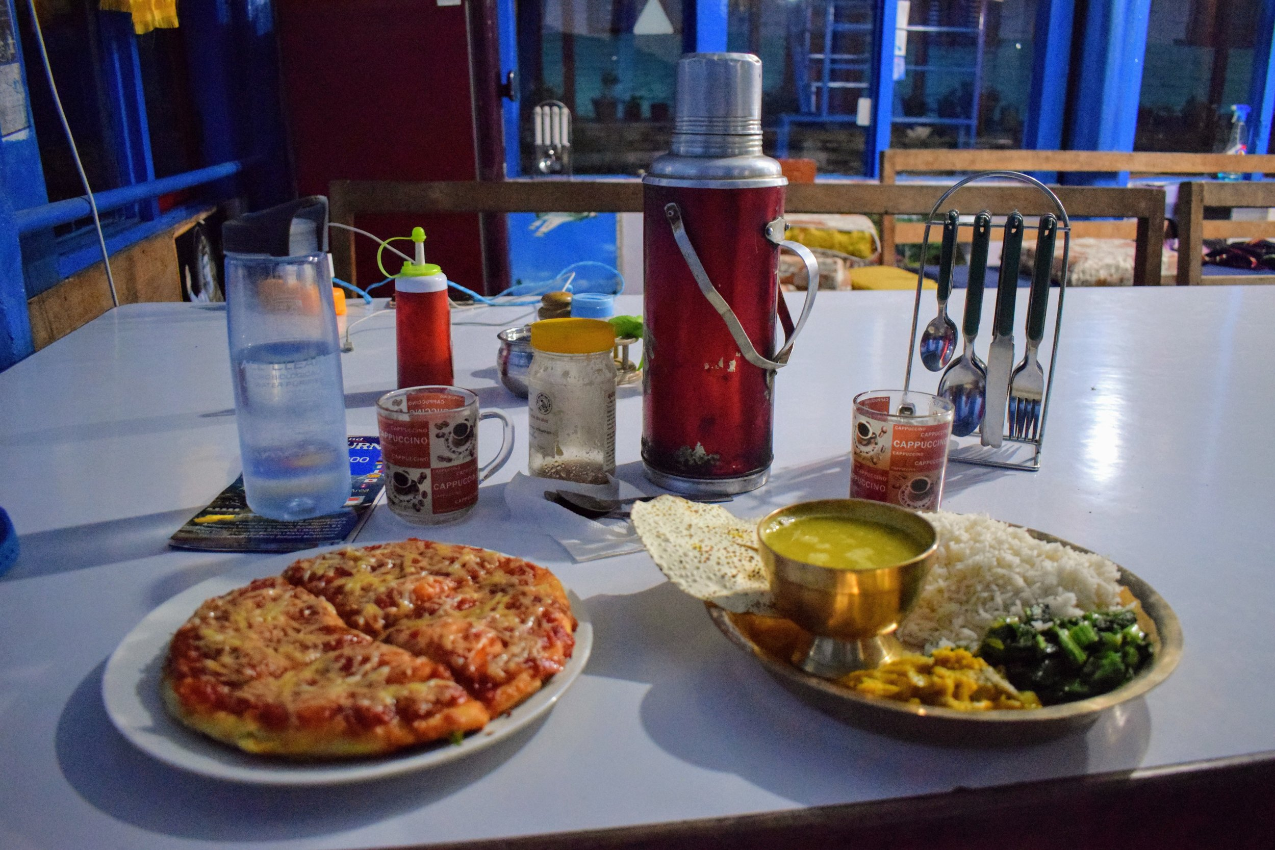 Yak cheese pizza, dal bhat, & a thermos of hot tea. The trekking dinner of champions. // Landruk, Nepal