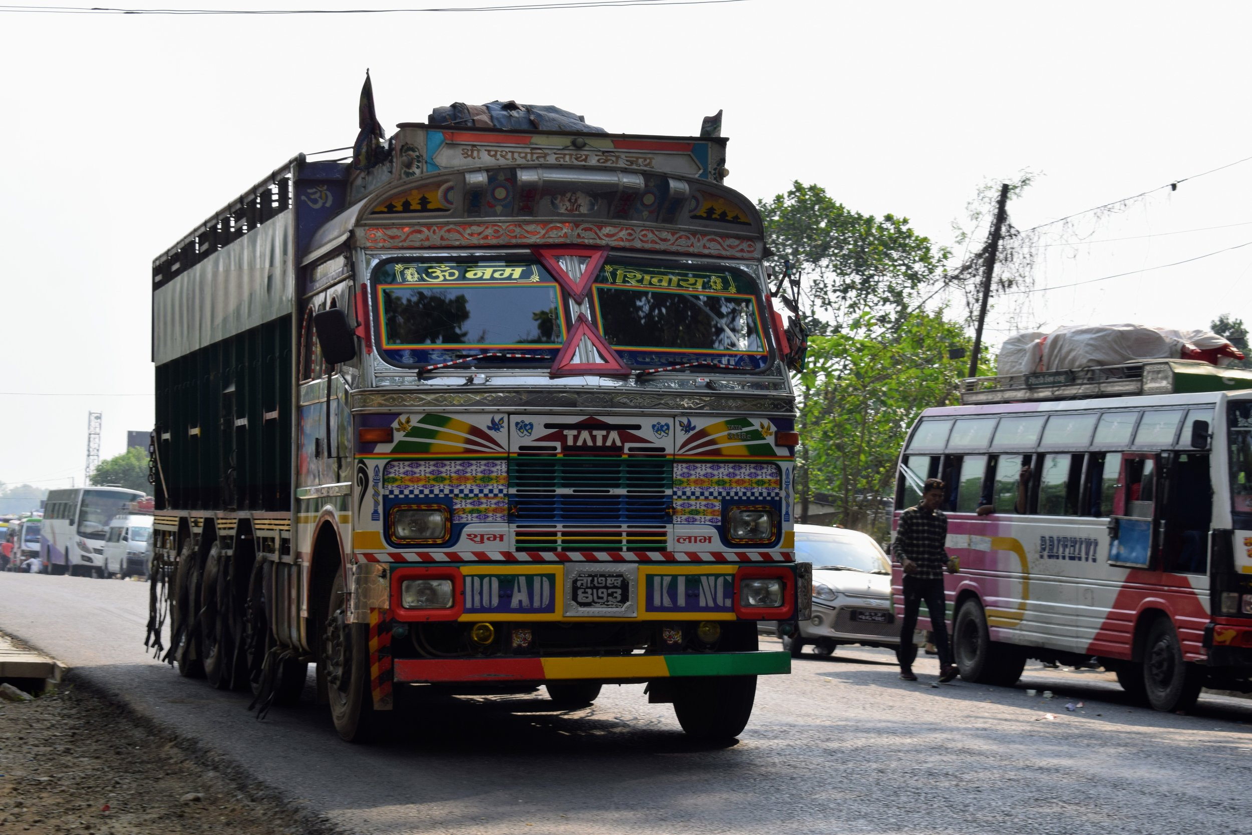 colorful decorated truck on the highway in nepal