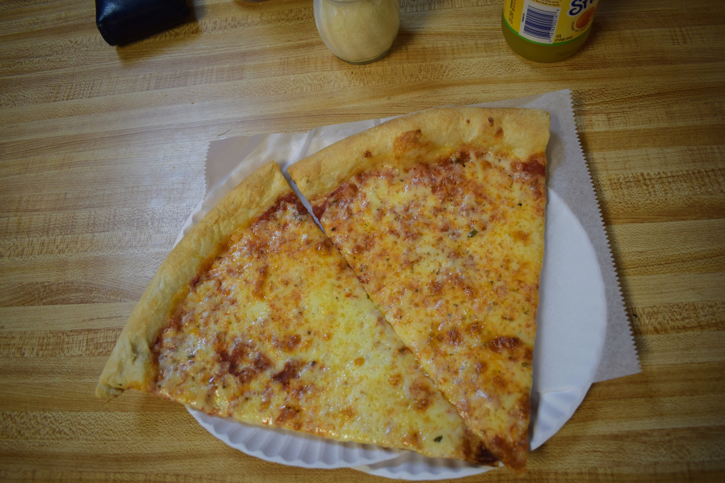 Two cheese slices from Vinnie's Pizzeria in Brooklyn.