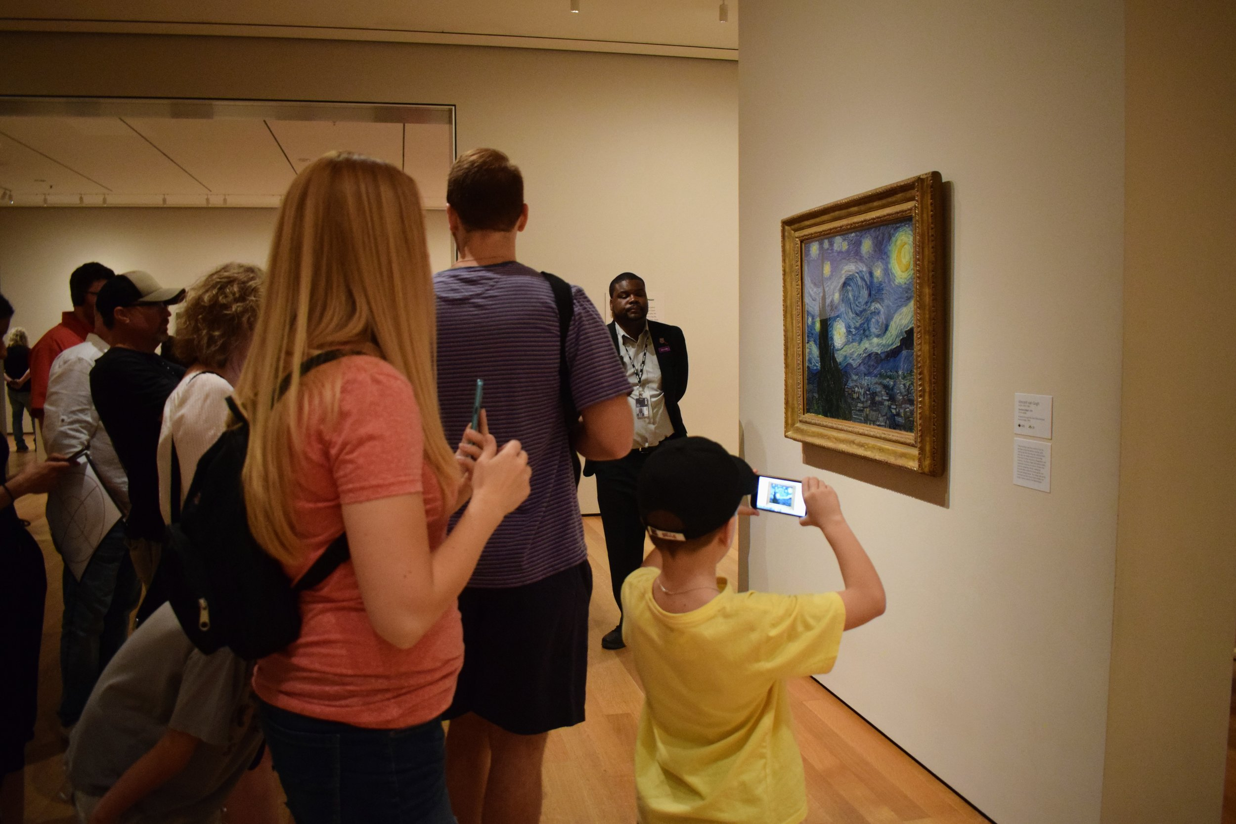 The small crowd photographing Van Gogh's Starry Night.