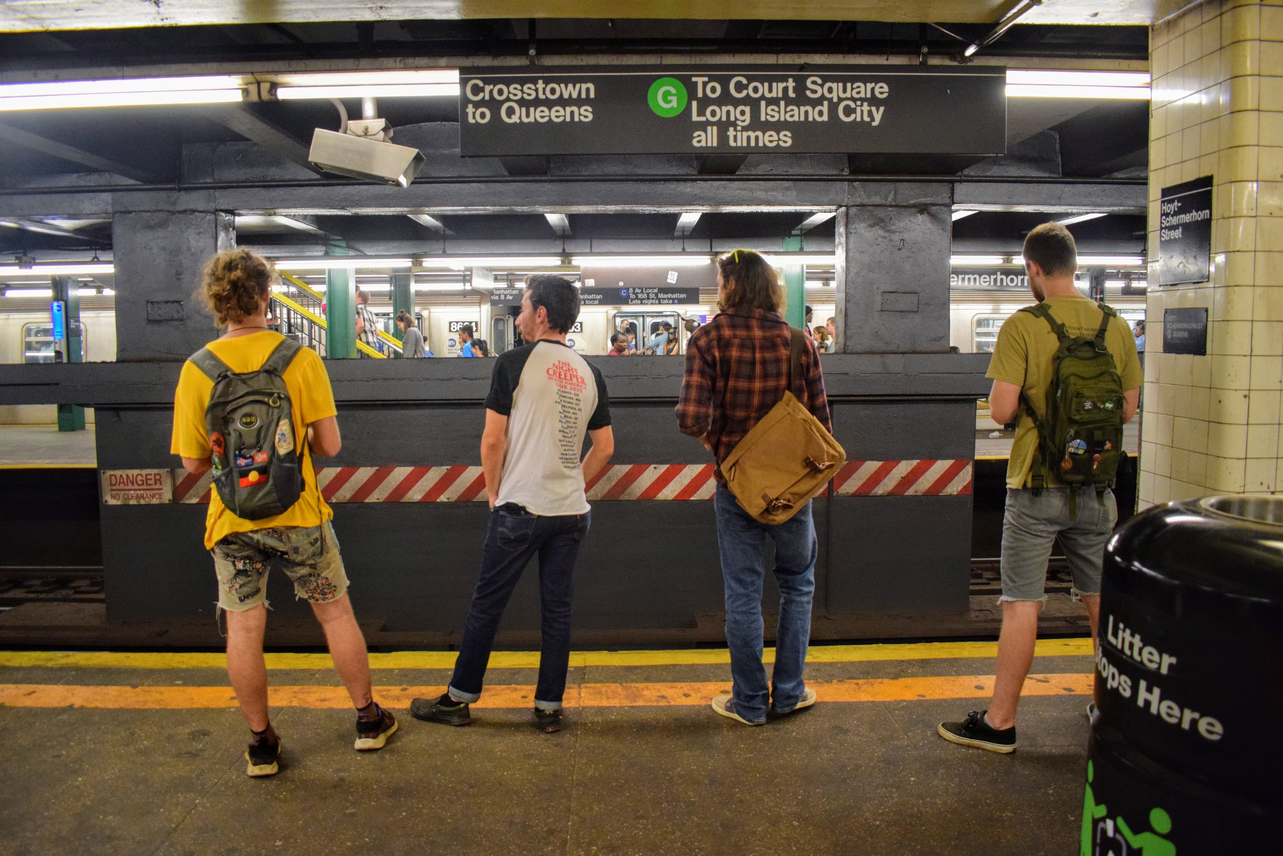 Our friends await the New York Subway's G Line.