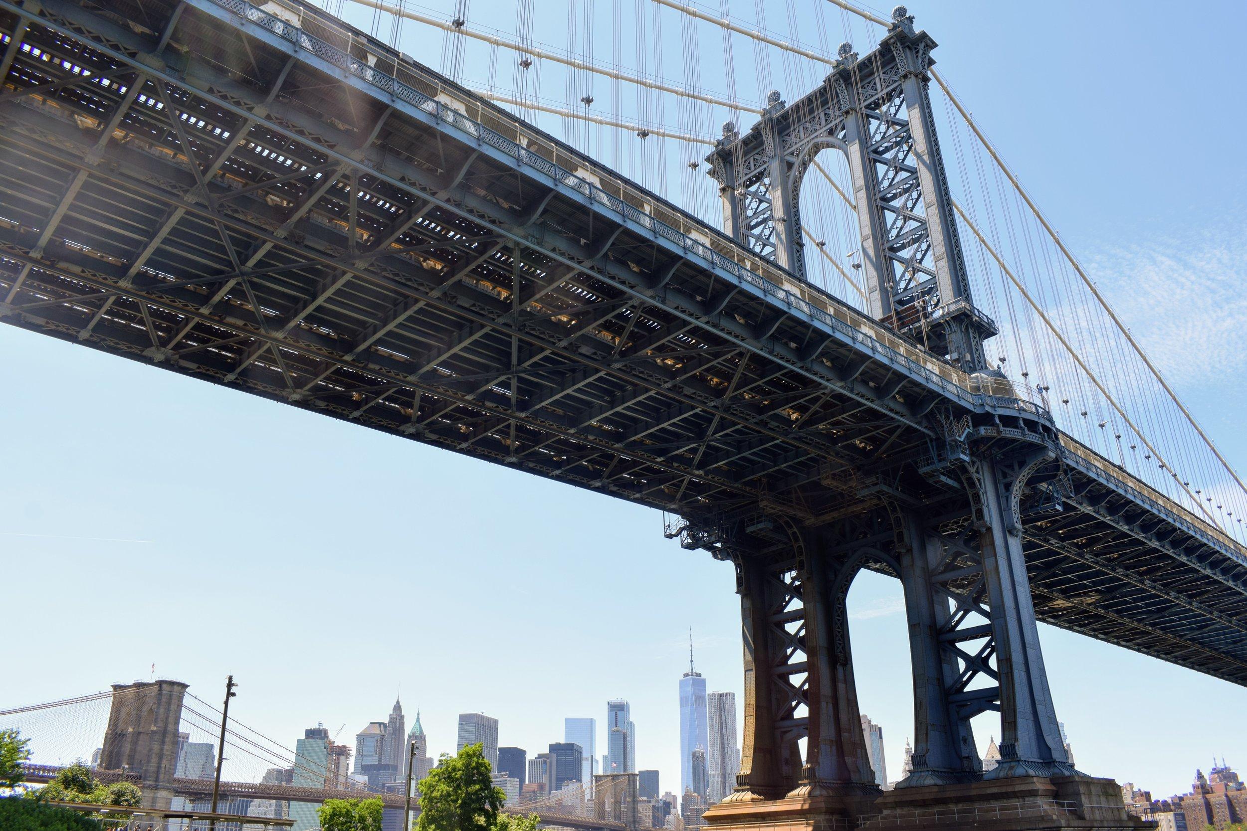 The Manhattan Bridge with One World Trade Center visible below.