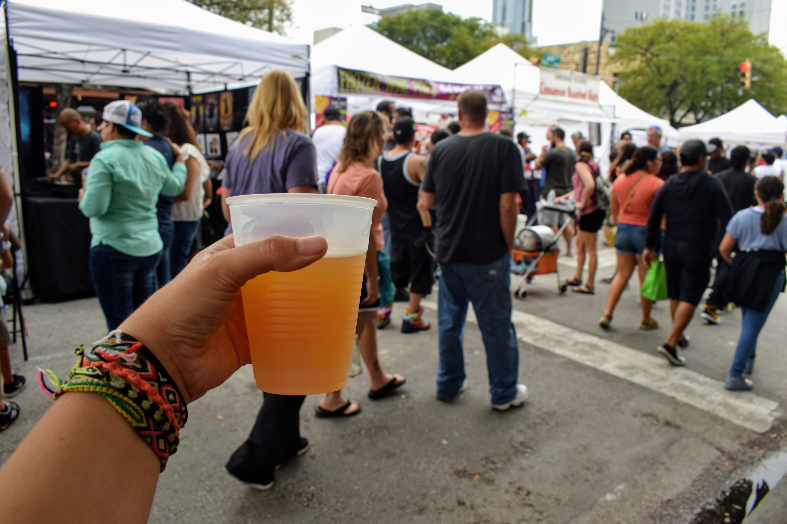 Me with my Austin Eastciders Cider in Blood Orange, walking the Pecan Street Festival.