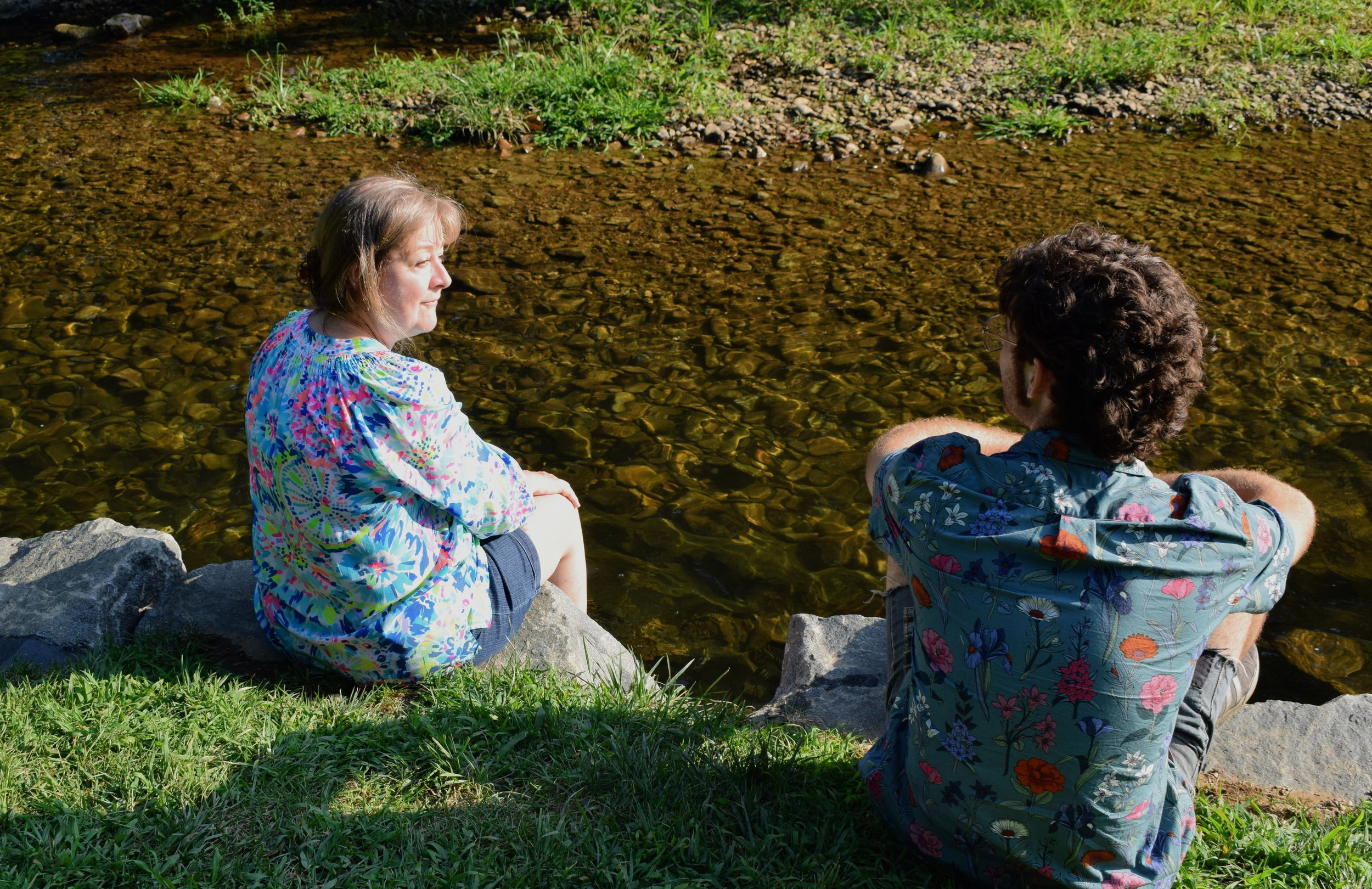 My Mom and Emmett soak up some sun at the stream on Bold Rock's Nellysford grounds.