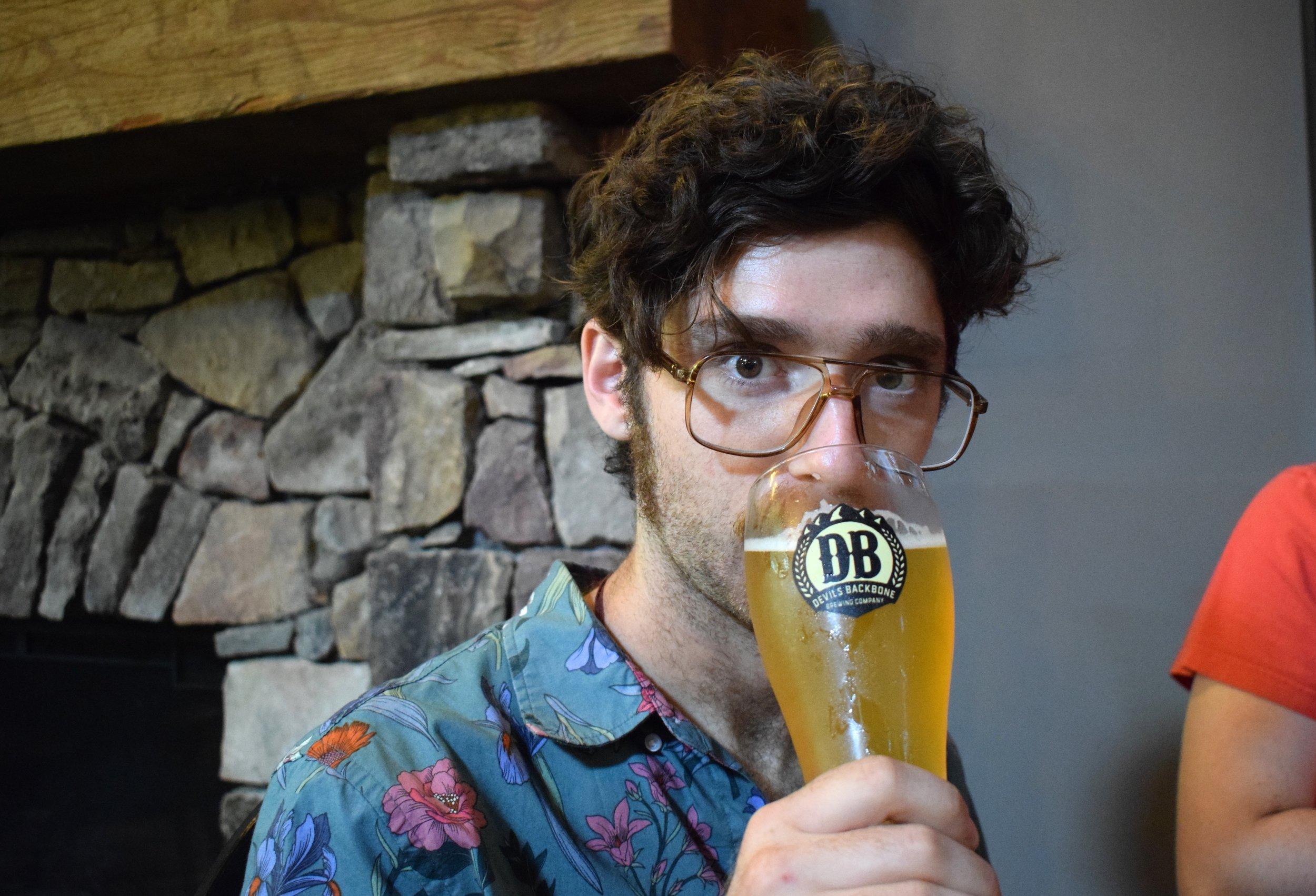 Emmett drinking inside Devil's Backbone Brewpub.