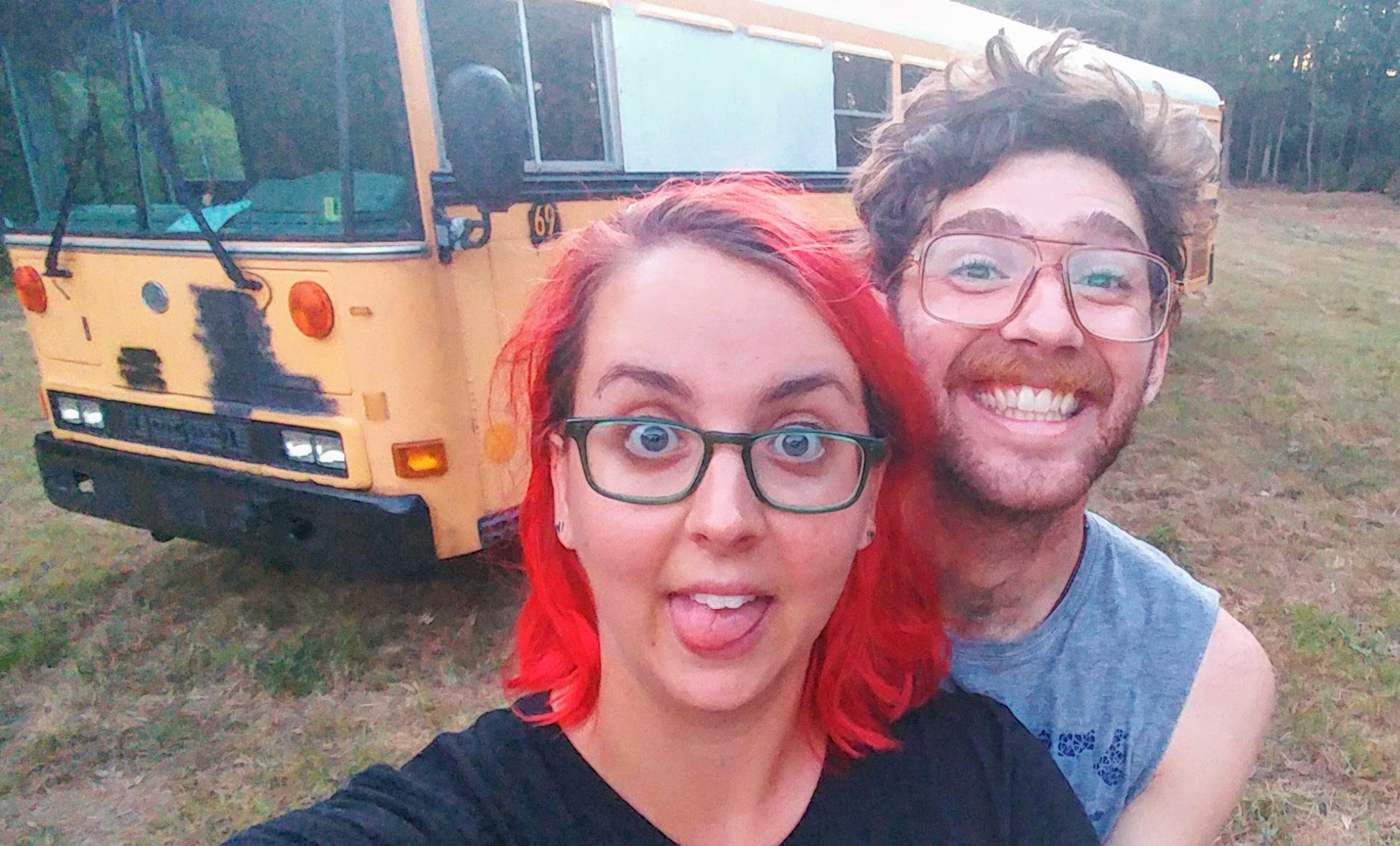 Us with our bus the day we bought her.