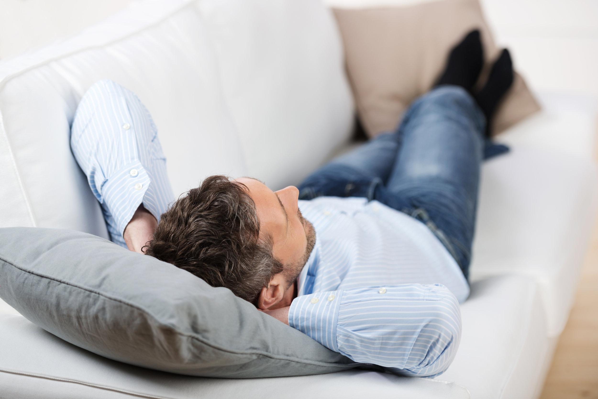 Man relaxing on sofa.jpeg