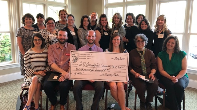 Pictured: 2018 Grant Recipients Grant recipients are, front, from left, Erin Predmore, MCUM executive director; Gabe Gloden, Cardinal Stage managing director; Principal Micah Heath and literacy coach Claire Mickey of Arlington Heights; Kate Cruikshank representing Teachers Warehouse; and Amy Stark, executive director of Girls Inc. In the back are Tri Kappas Judy Hoke, Bethany Murray, Aggie Sarkissian, Amanda Burnham, Nancy Gettinger, Stephanie Williamson, Trish Smith, Megan Parmenter, Carol Stanton, Stephanie Oyler, Beth Theile, Betsy Feeny and Kathy Strickler.