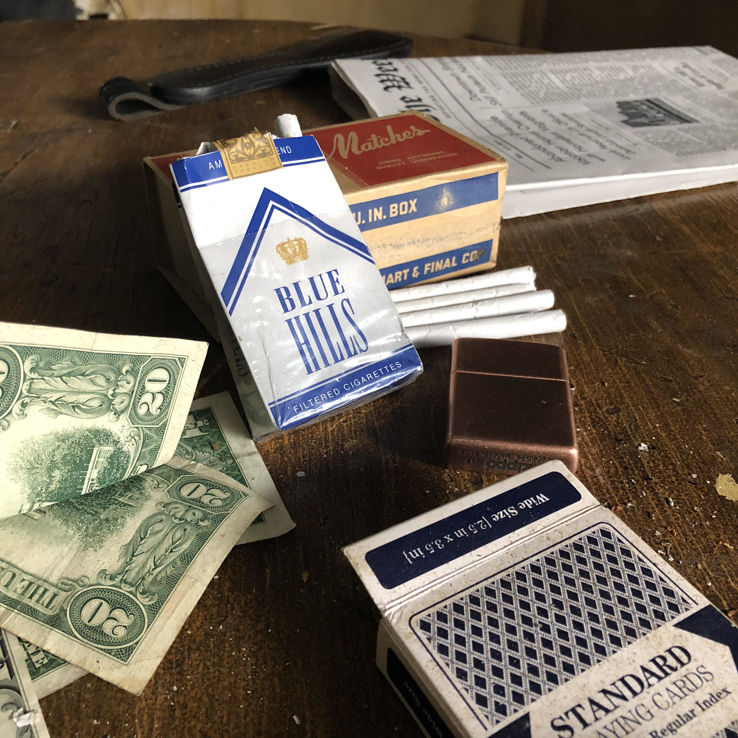 Cigarettes, cards and money - Ellroy essentials.   Photo courtesy Drew Powell
