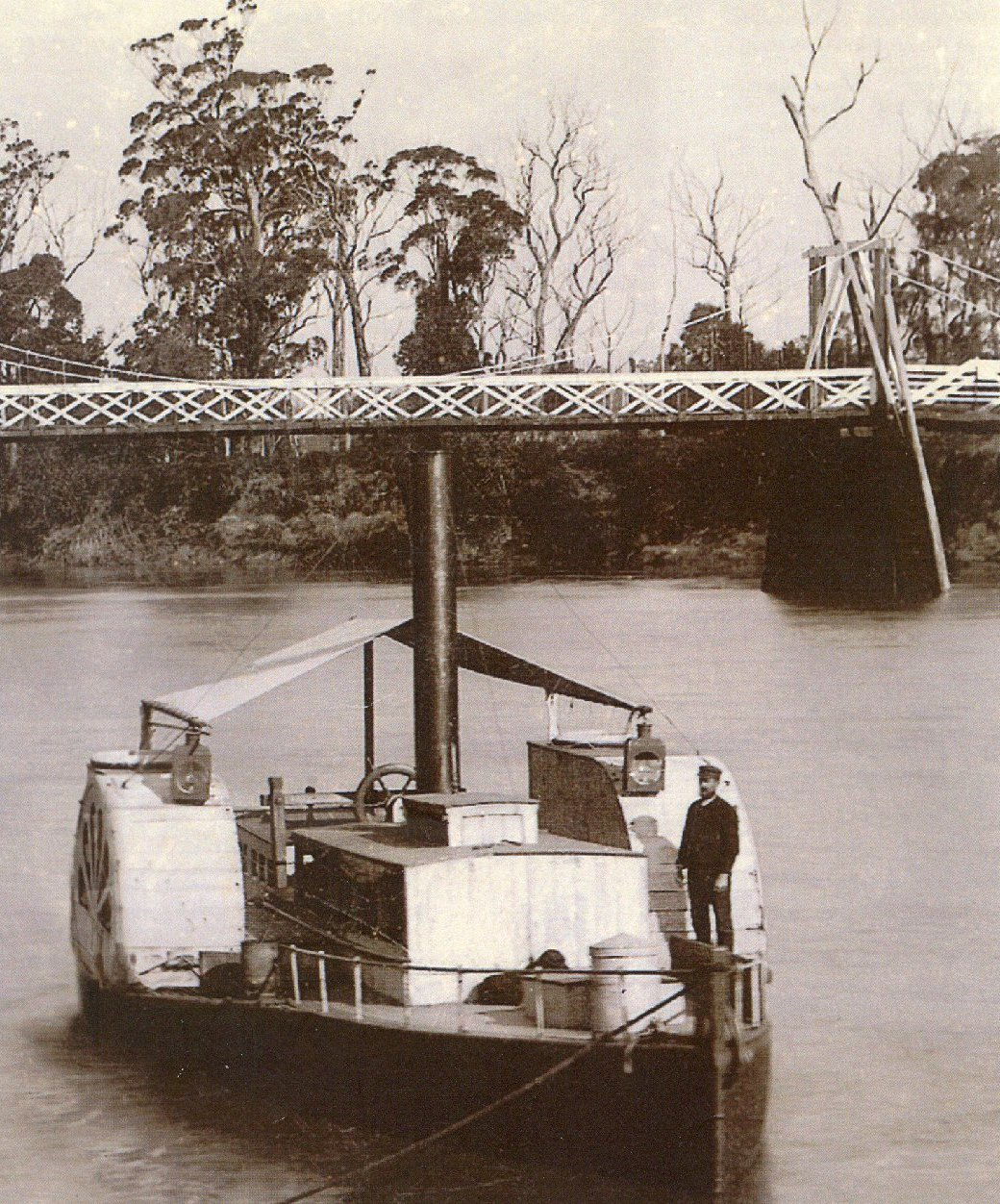 This image was taken, later in the life of Paddle Steamer Curlip, around July / August 1897. She is sporting a new taller funnel, with guy wires attached, her hull colour was painted a darker colour Green, with Copper paint underwater. Frank Richardson is standing on the deck.