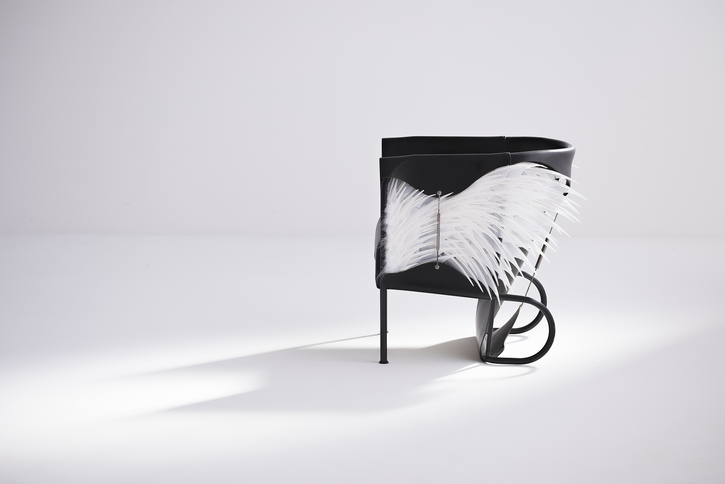 Accoutre_feather_armchair-8 low res.jpg
