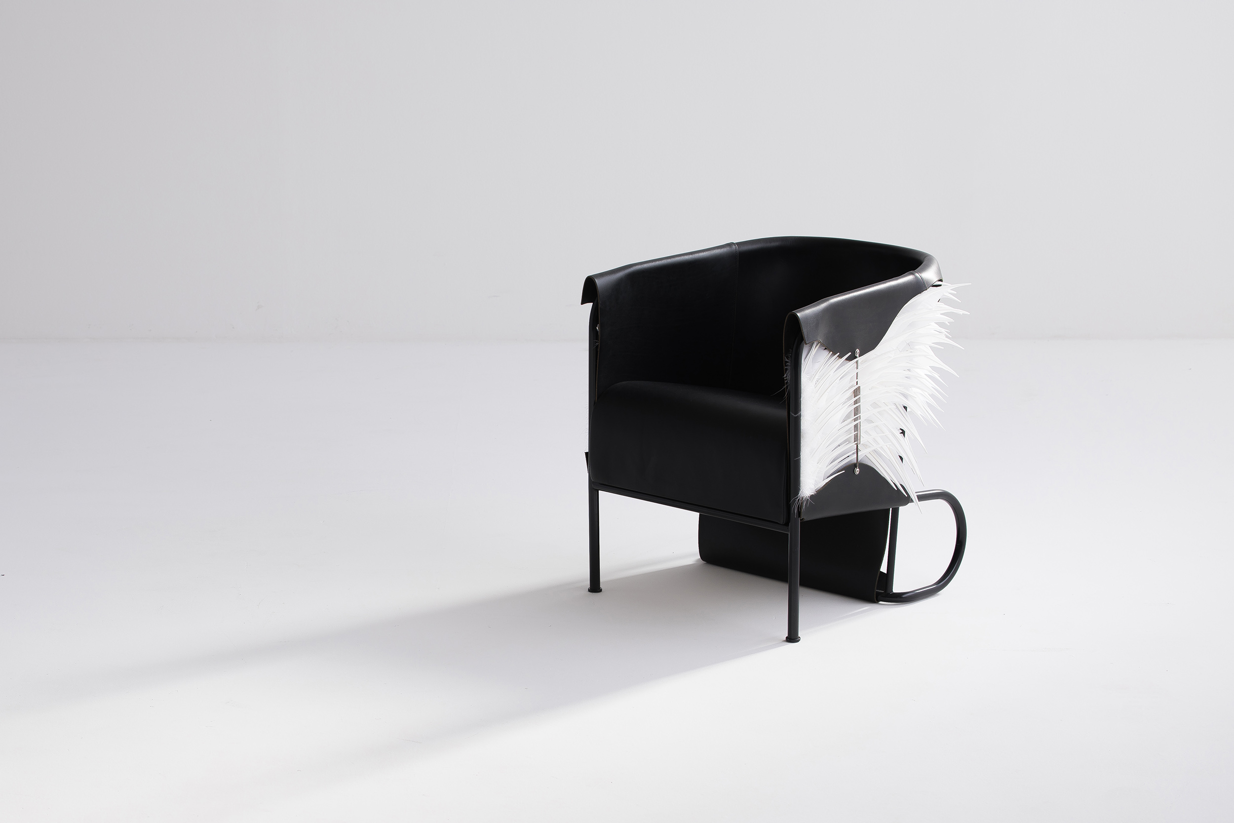 Accoutre_feather_armchair-7 low res.jpg