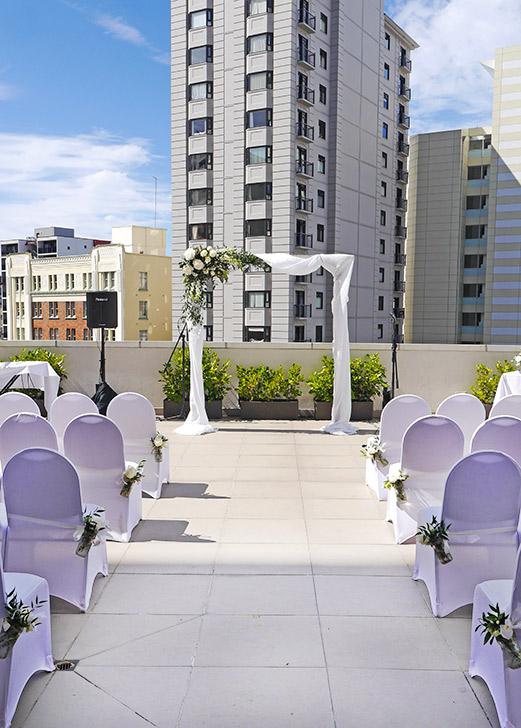 wedding-ceremony-wooden-arch-white-flowers-auckland.jpg