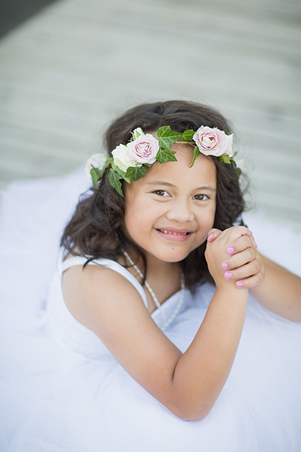 Flower girl ivy circlet with blush and ivory spray roses, captured by  Poppy Moss