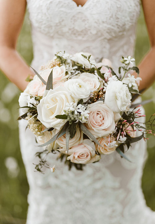Blush and champagne rose and ranunculus bouquets. Captured by  Wild and Grace.