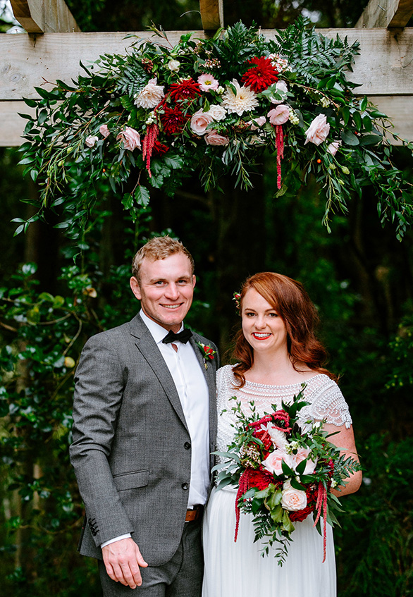 Maroon Dahlia and Blush Roses with lush greenery. Captured by Soul Sisters Photography at Kumeu Valley Estate.