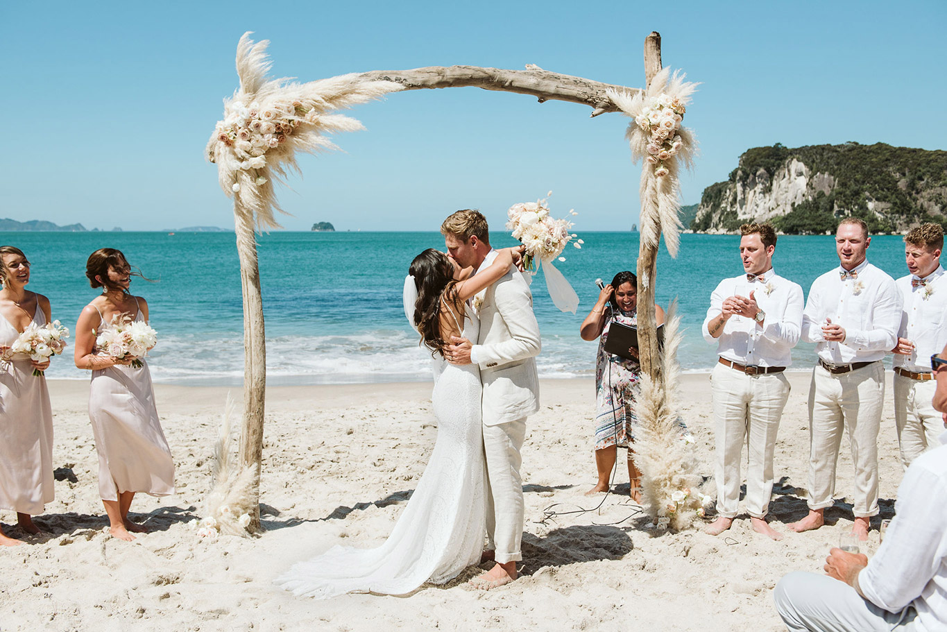 blush-arch-beach-wedding-flowers-auckland.jpg