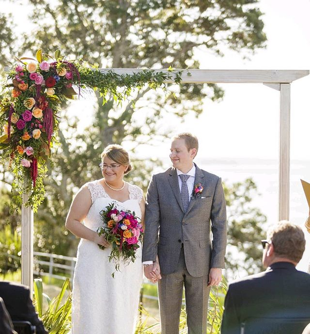 Michelle and Michael with their fun bright ceremony flowers at @theofficersmess... Such a fab venue for a wedding in historic Devonport surrounded by stunning views. Photo by @jodiecphoto #brightandbeautiful #weddingceremony