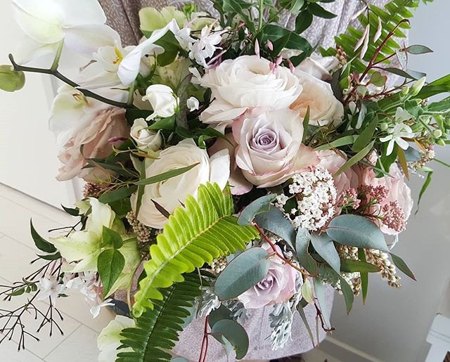 A gorgeous wild mix of ferns and flowers for LeAnn. The pic just does not do this bouquet justice!
