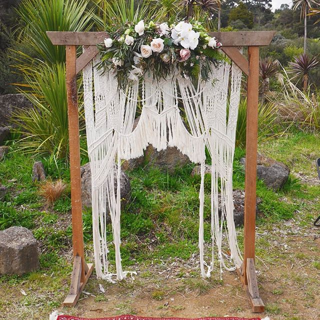 This cute lil arch and handmade macrame drape) made by the bride). #crafty #talented #weddingarch @littlewildernessnz