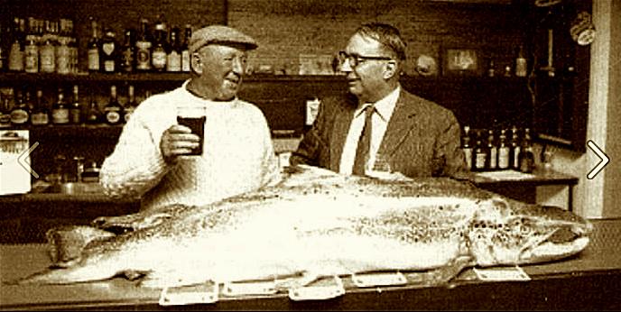 Celebrating in the Pontoon Bridge Hotel near Lough Cullen, a fine 50 pound (23 kilo) male wild Atlantic salmon, caught by John Dempsey