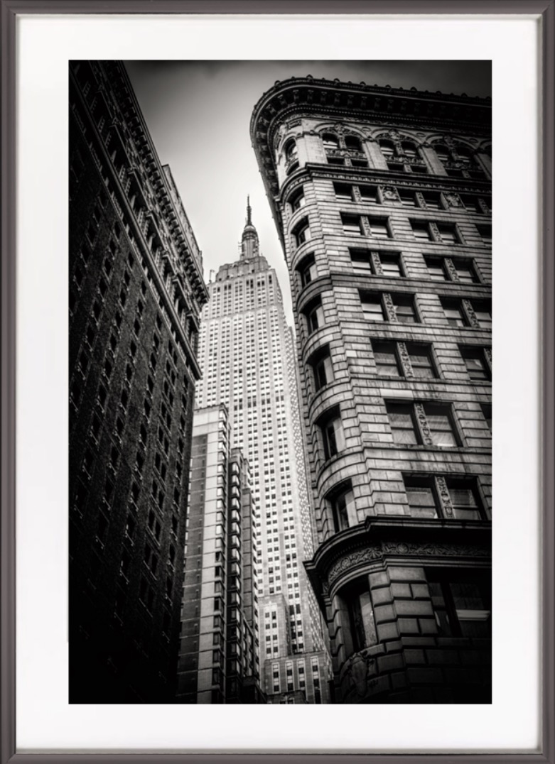'Awesome image'. - I've never bought a photograph before but when I saw Jim's work I had to have some. I love New York and this picture of the Empire State being squeezed between two other buildings brings the scale of the city home.Richard Jenkinson, Dunfermline.