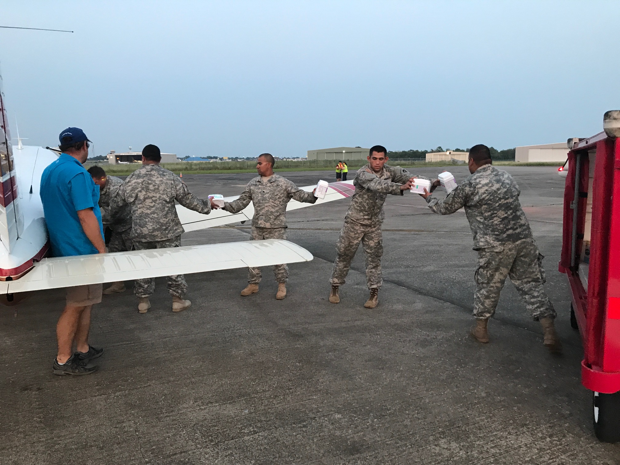 One of our pilot volunteers, Bryan Venable, supervising the National Guard during an offload at KBPT.