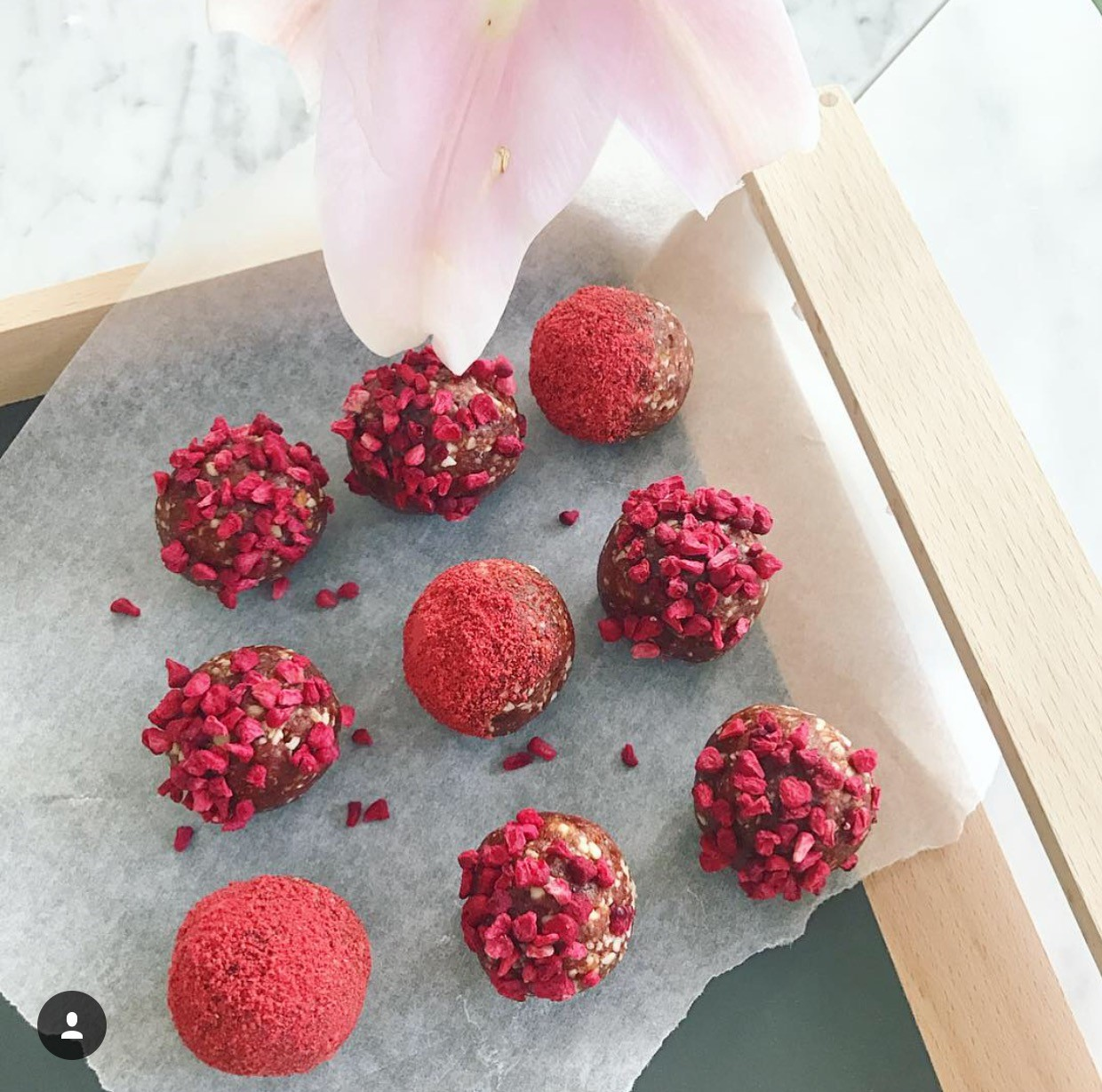 Ingredients:  1 cup almonds  1 cup medjool dates 1 tsp vanilla essence  1 tbsp raspberry powder   optional for rolling: freeze dried raspberries, additional raspberry powder.  Method: 1. Place the almonds into the food processor and blitz until slightly broken down. 2. Add in the dates, vanilla and raspberry powder and blend until well combined and a dough texture is formed. If your dates are not sticky enough you may need to add in a few more. 3. Remove the dough from the food processor and roll into balls. Further roll in freeze dried raspberries or raspberry powder. 4. Store in the fridge until ready to eat.