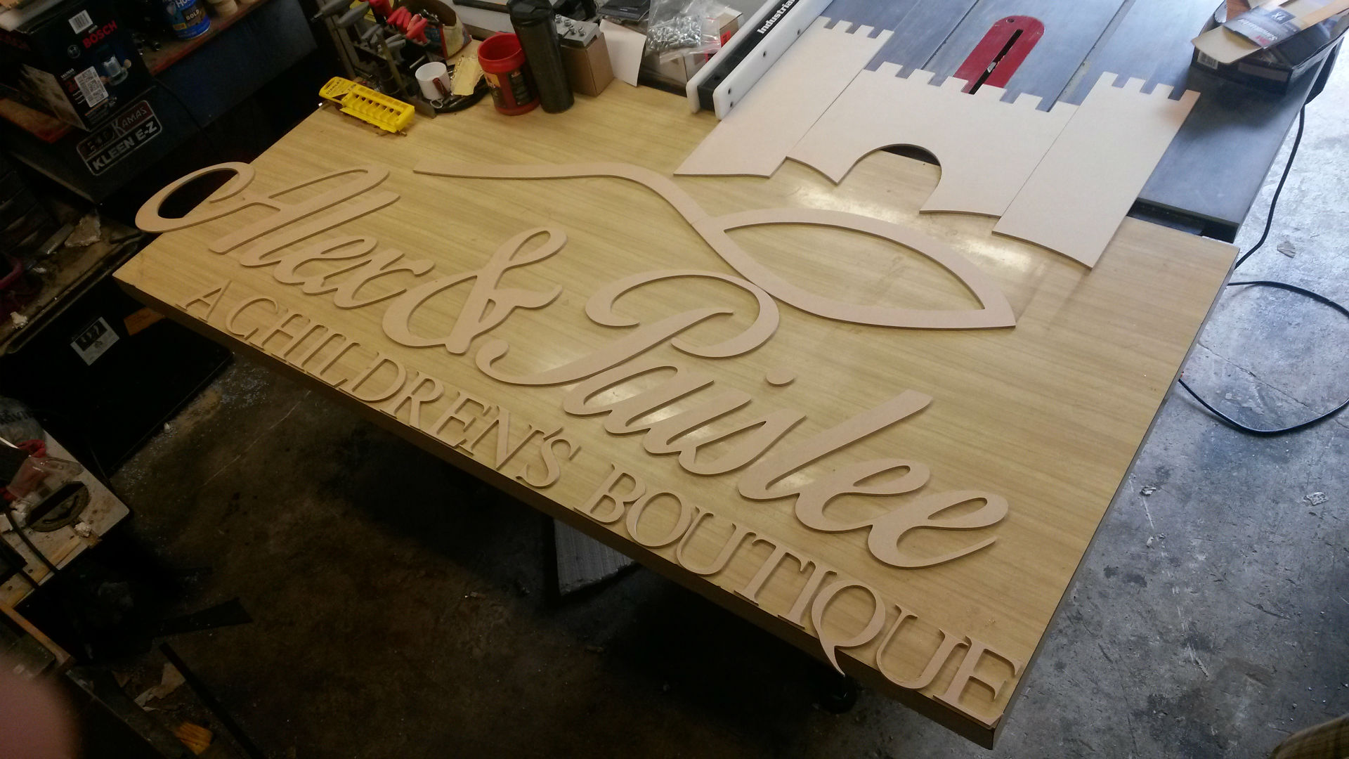 Dalton CNC Portfolio. Alex and Paislee's Children Boutique Sign Cutout by CNC Routing Machine.