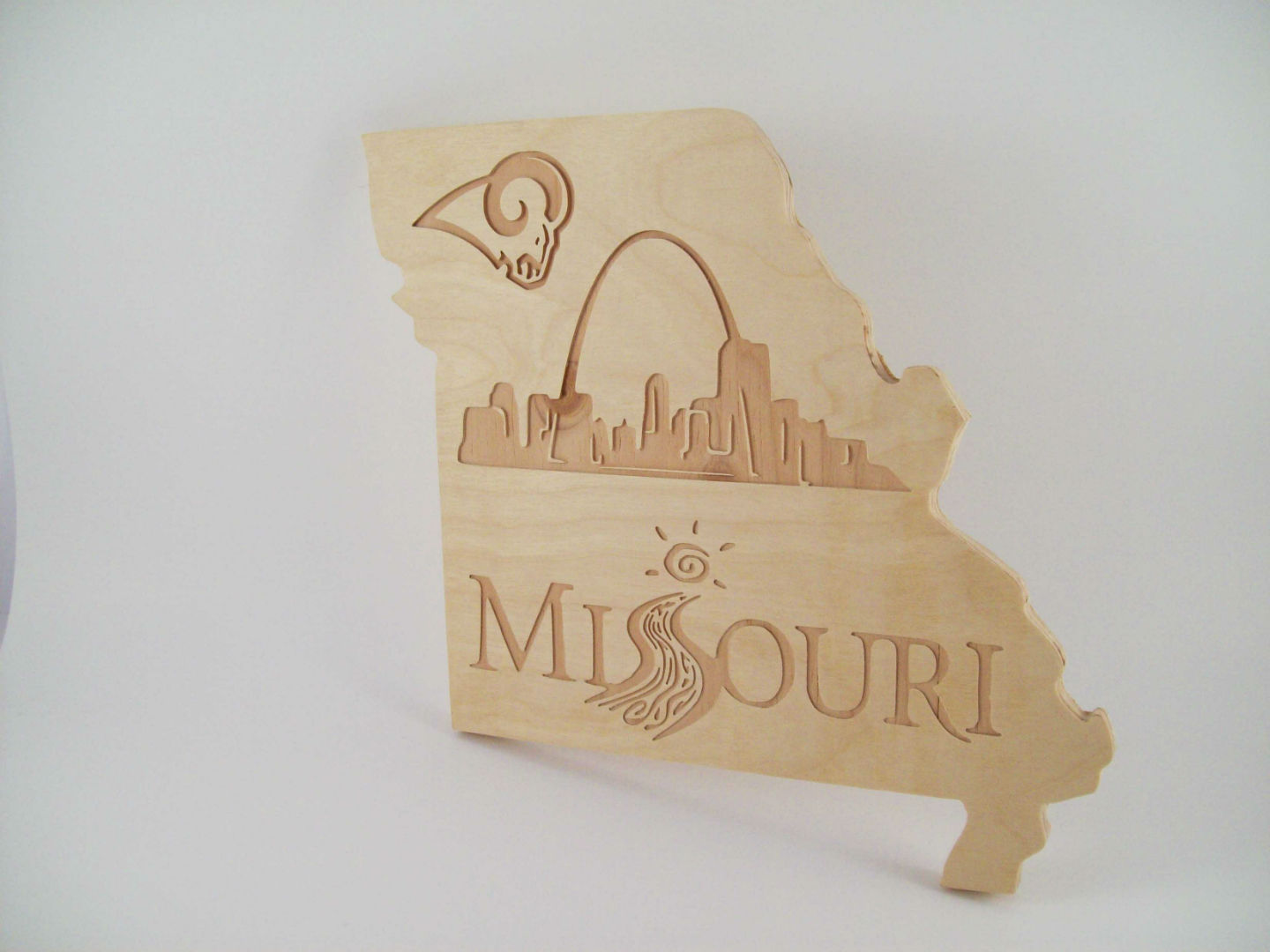 Dalton CNC Portfolio. State of Missouri cutout with Missouri Logos and skyline.