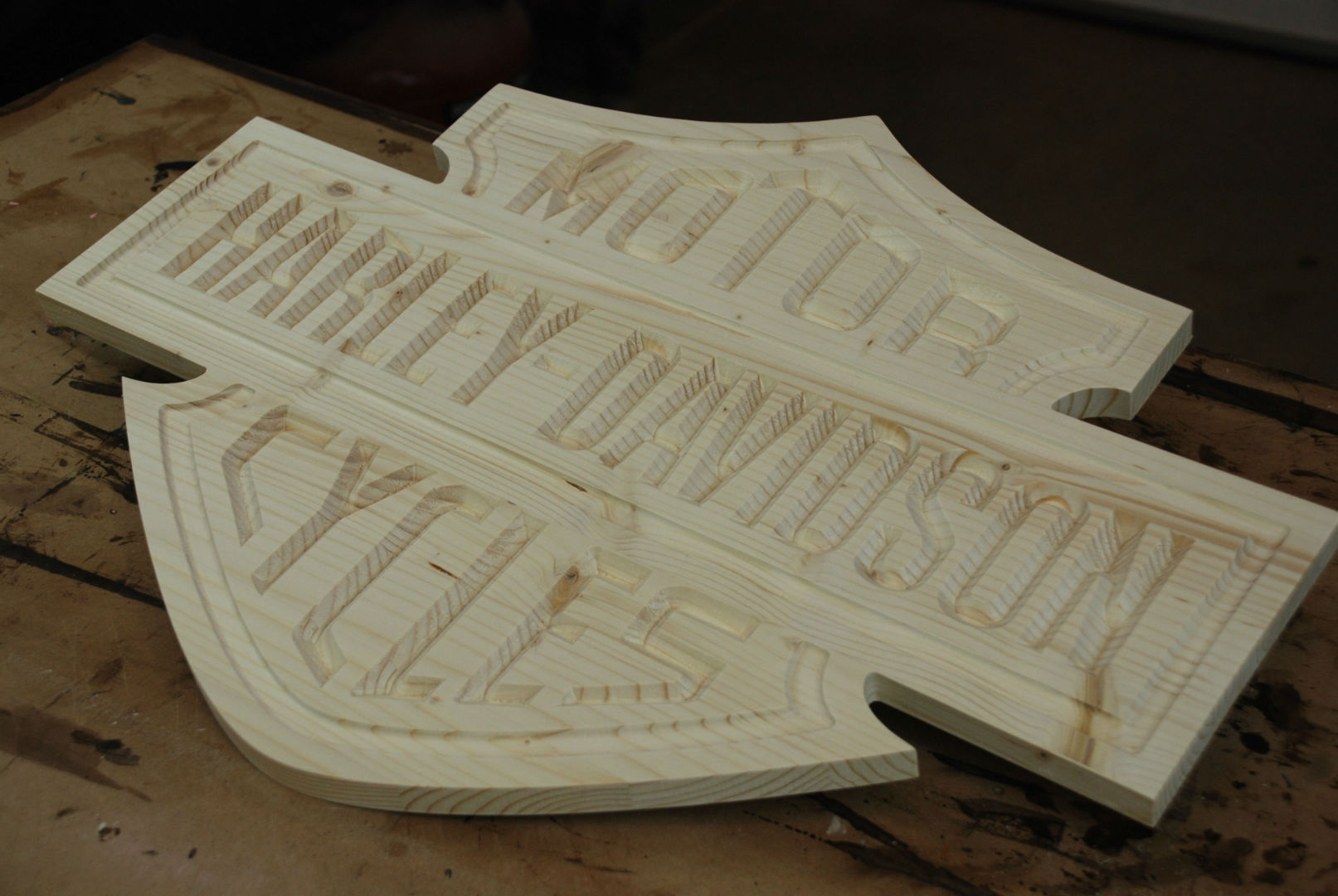 Dalton CNC Portfolio. Harley Davidson Motorcycles logo on wooden sign.