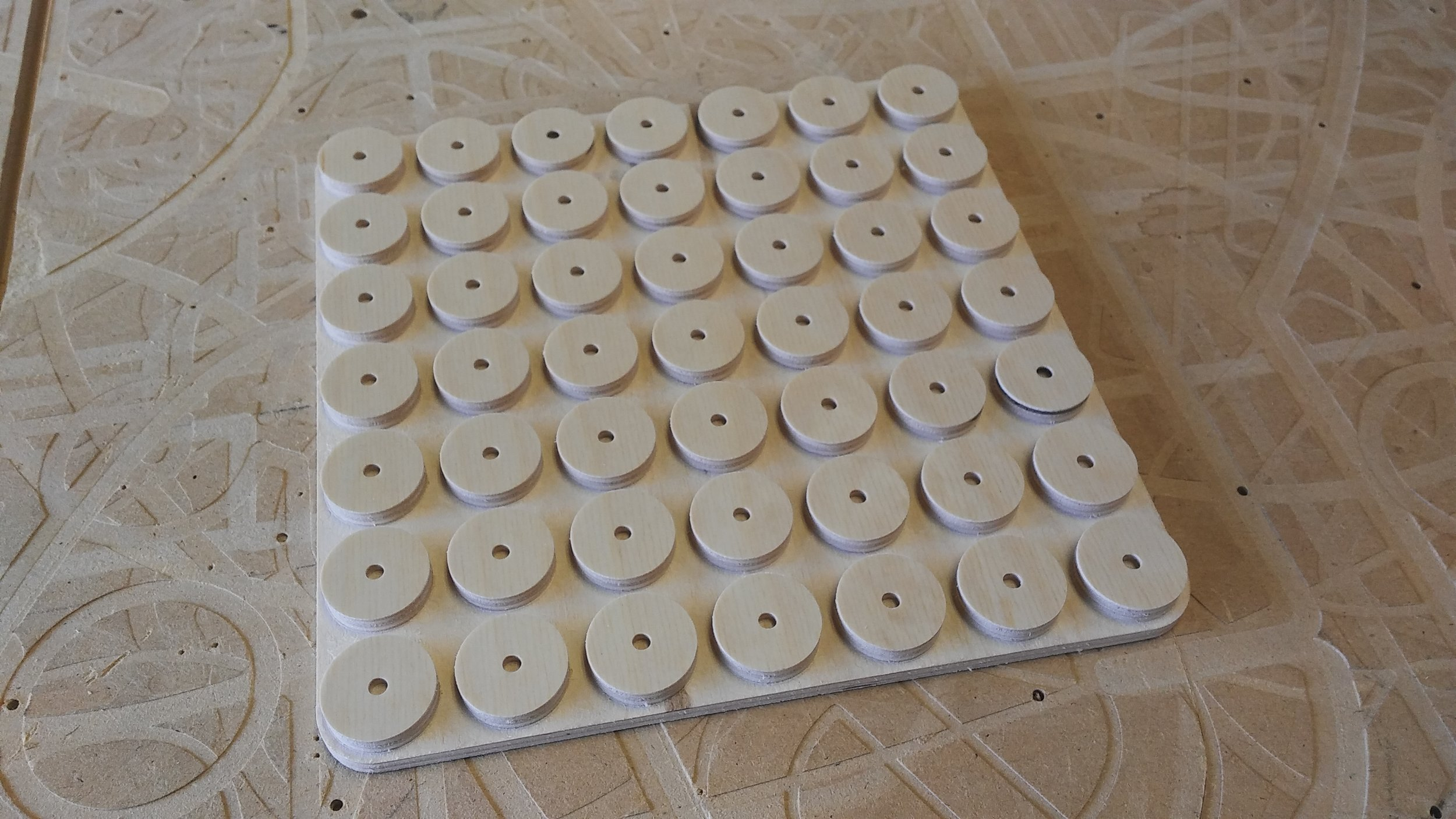 Dalton CNC Portfolio. Perfect circles repeated by CNC Routing Machine.