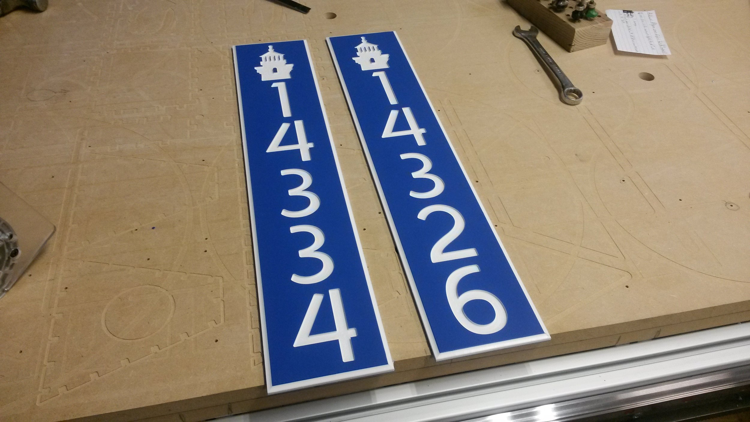 Dalton CNC Portfolio. Plastic Street signs cutout by CNC Routing Machines.