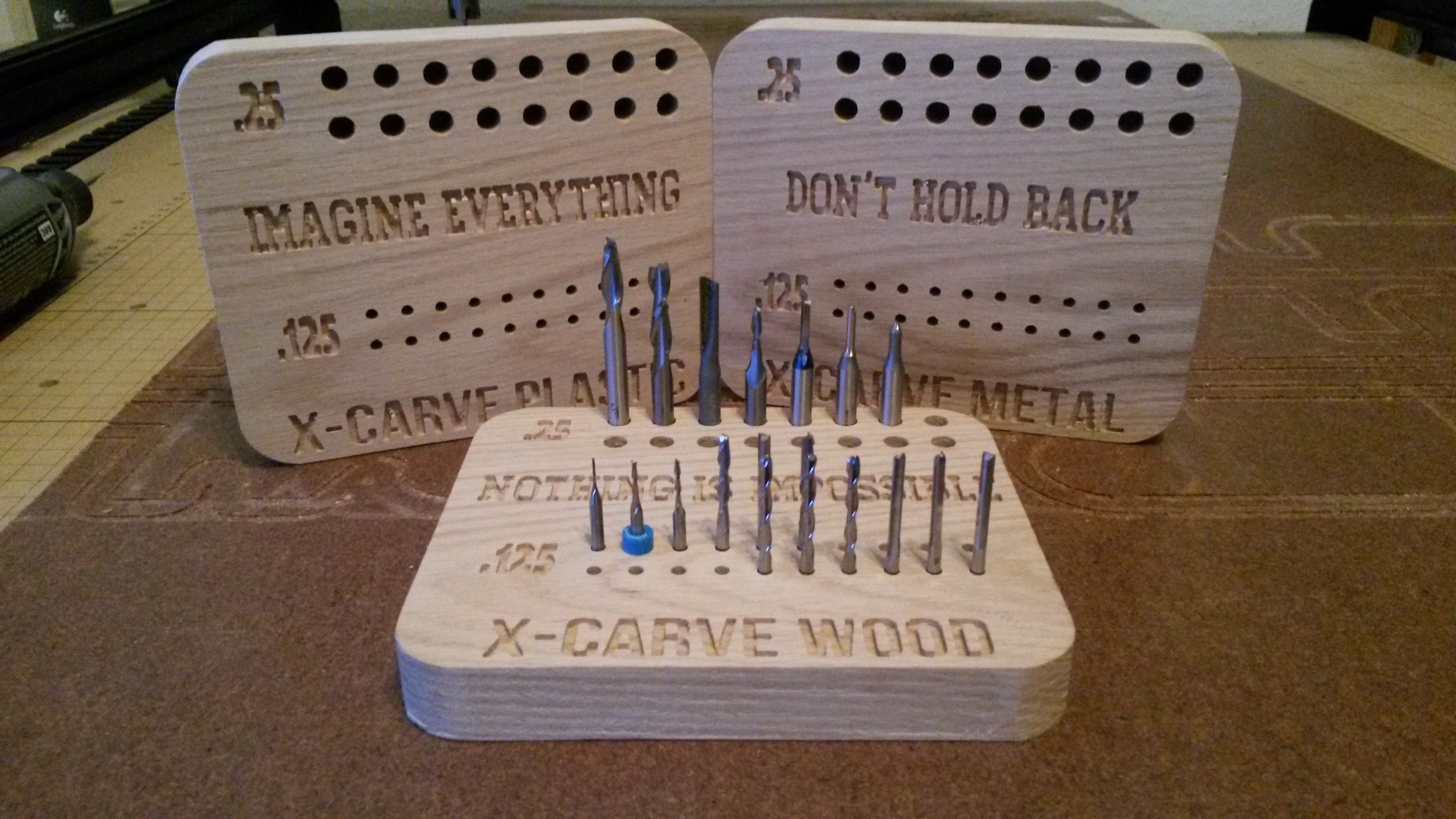 Dalton CNC Portfolio. Wooden drill bit holder with names and logos carved in.