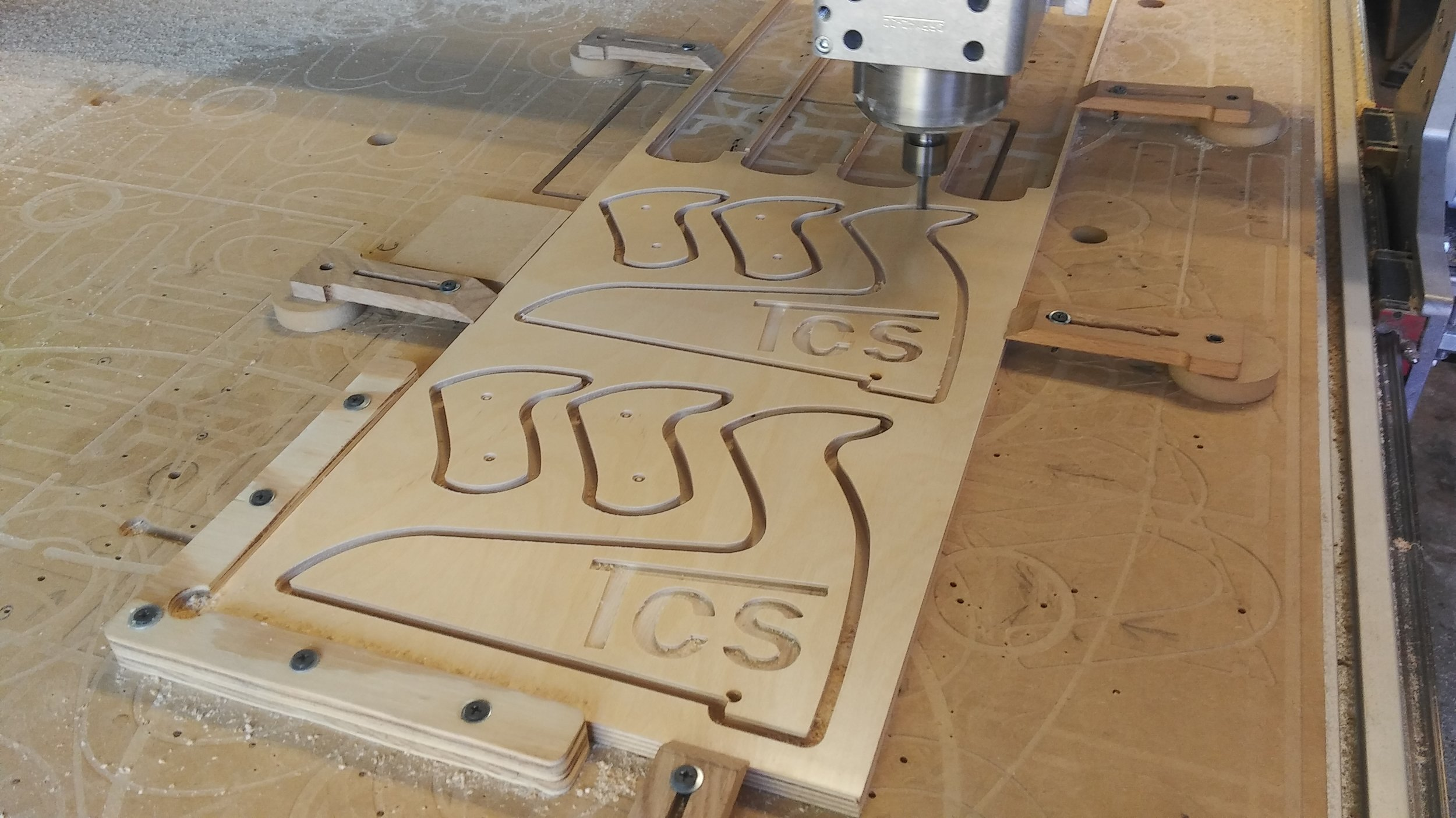 Dalton CNC Portfolio. Company logo cutout by laser engraving CNC Routing Machine.