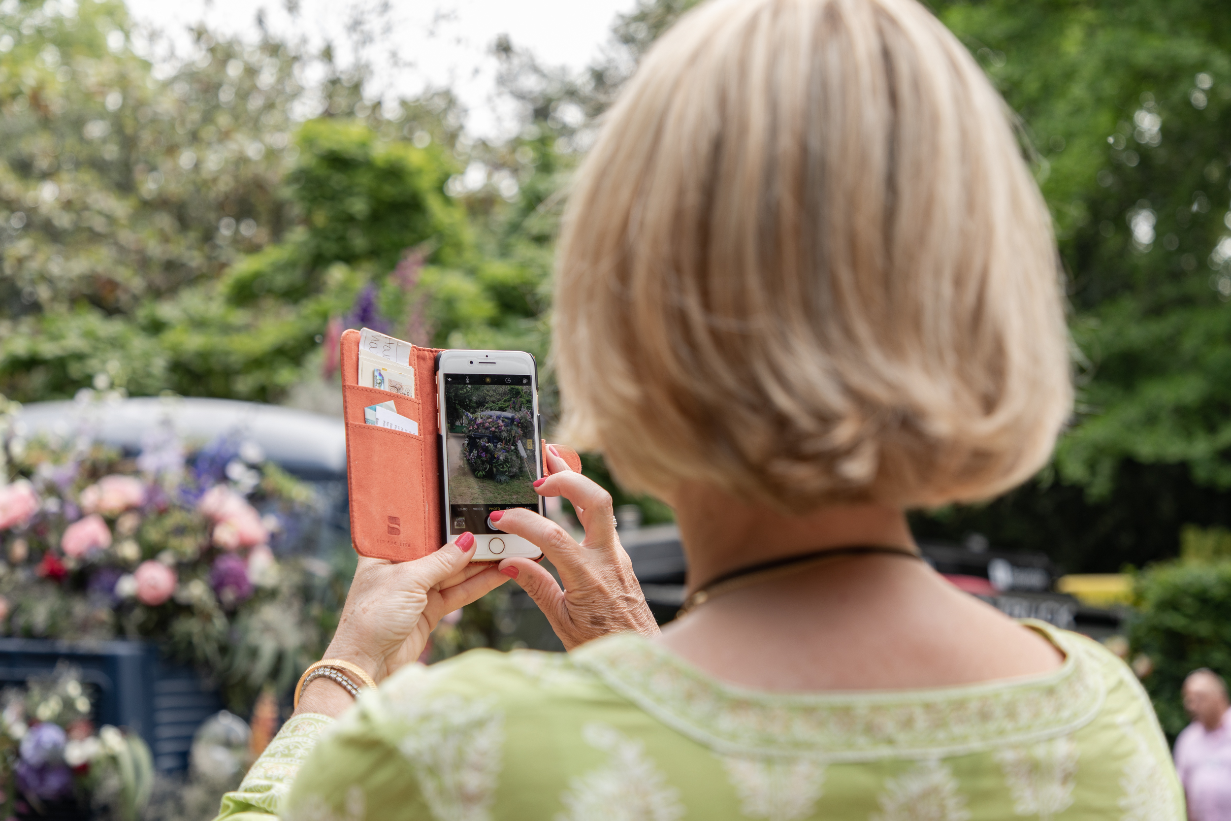 A visitor at this years RHS Chelsea Flower Show grabbing a quick image on her phone.