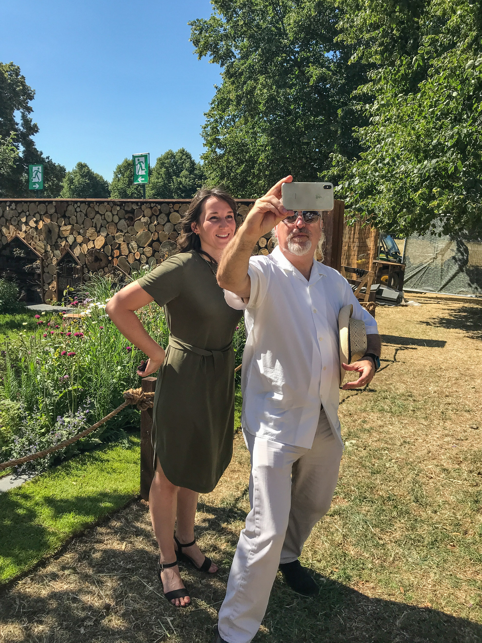 Bill Bailey at Hampton Court Flower Show grabbing a selfie with designer Lilly Gomm