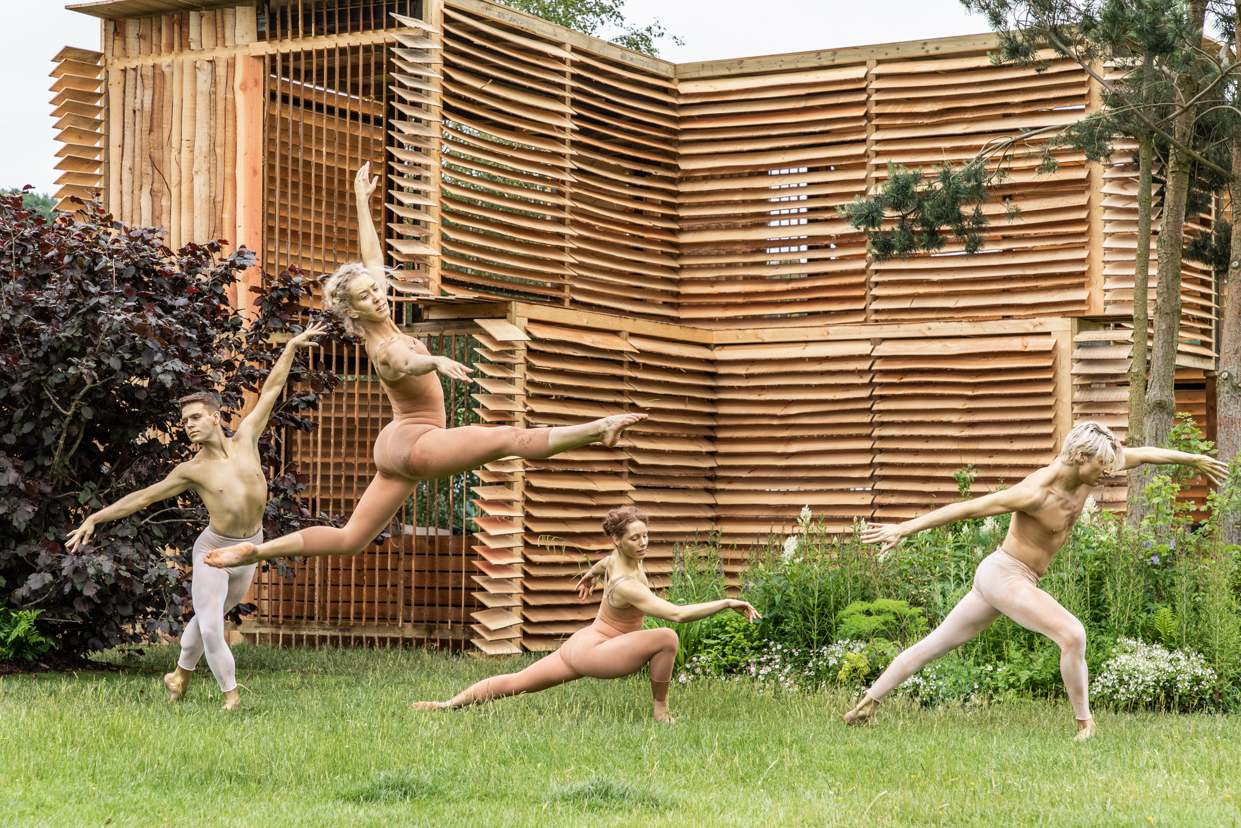Dancers from the International Art Collective performing on the Brewin Dolphin Garden at this years RHS Chatsworth Flower Show.