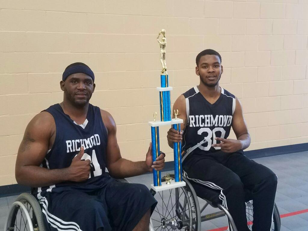 Cor'Rales and a teammate celebrate a Richmond Rim Riders victory. Photo courtesy of Cor'Rales Dupree.
