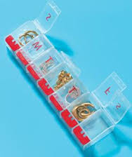 A selection of different pill cases can be used to store earrings and rings. Either a standing tube style (left), or the long one (above), or both! These can be found super cheap at any drug store.