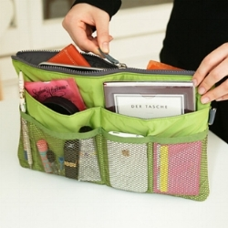 I am loving this organizer by  MochiThings . They come in a bunch of fun colors and are just $37.99! The act of endlessly searching for what you need while in a hurry or sitting on a plane is cut in half with this hack!